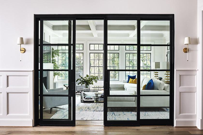 Black framed glass doors open to family room