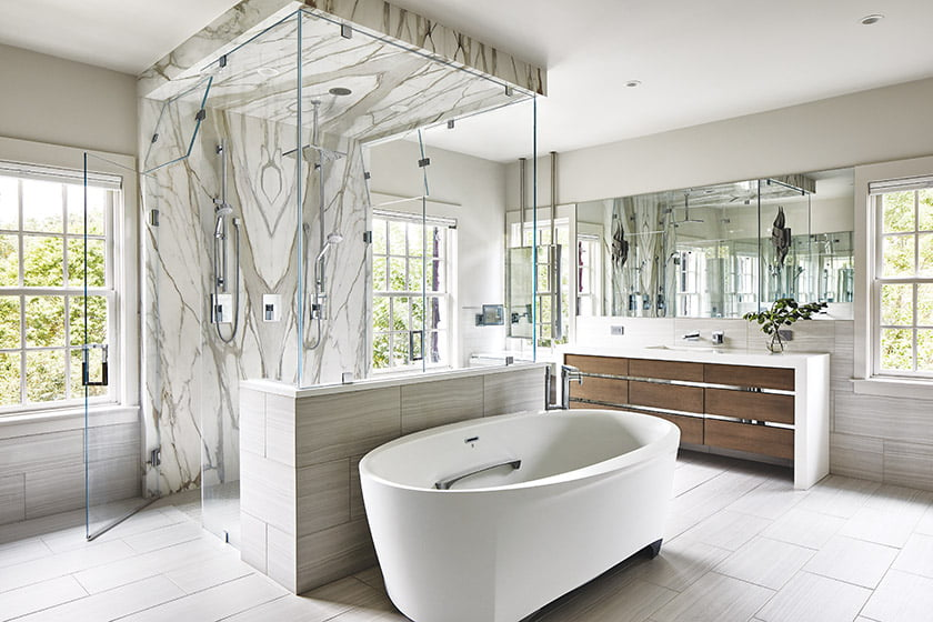 Glass-enclosed shower in owners bath