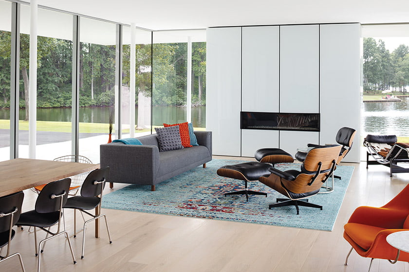 Great room with Safavieh rug Herman Miller sofa and Eames lounge chairs and ottomans
