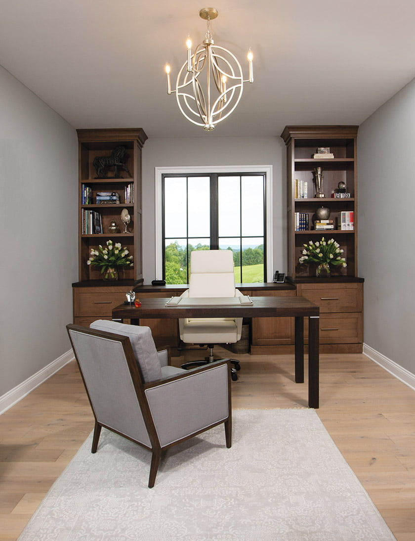 Home office with built-ins behind desk