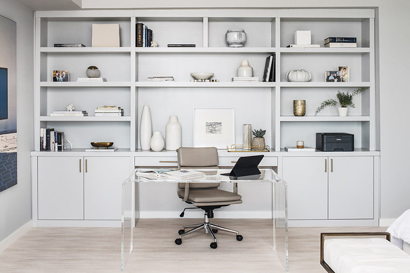 Custom built-in and a desk create a home workspace in bedroom