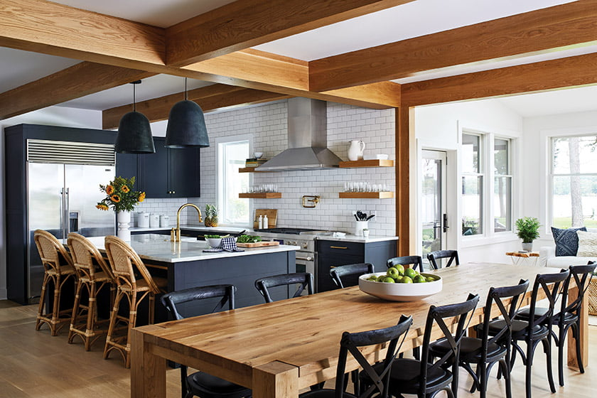 Dining oak table with Signature Custom Cabinetry and quartzite countertops