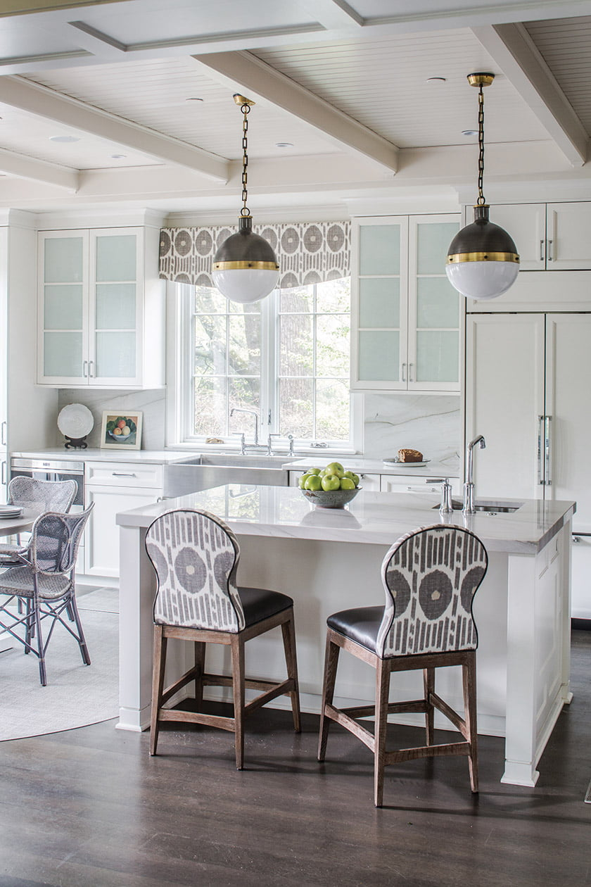 Kitchen cabinetry featuring countertops and an integrated backsplash in quartzite
