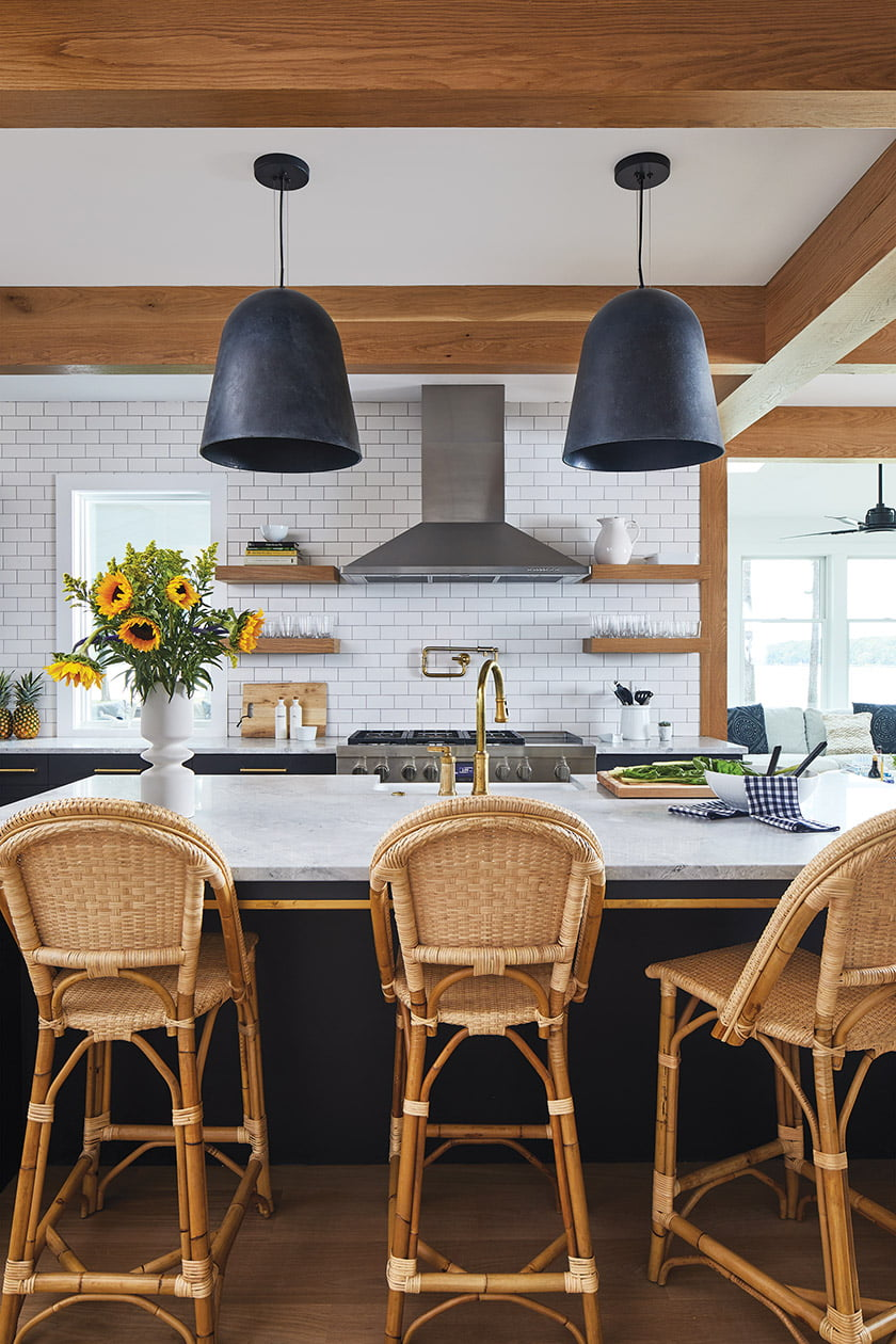 Kitchen with white oak accents and woven Serena & Lily stools