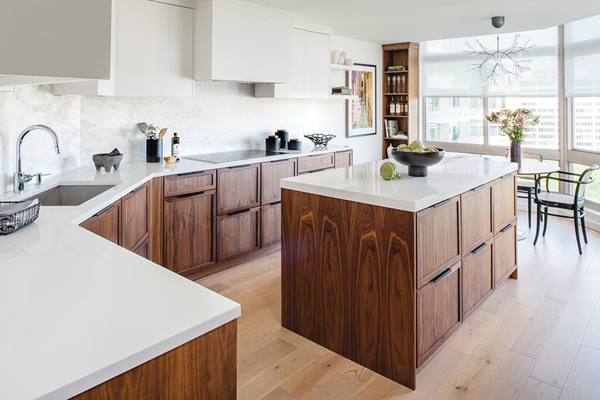 Kitchen walnut base cabinetry and white upper cabinets