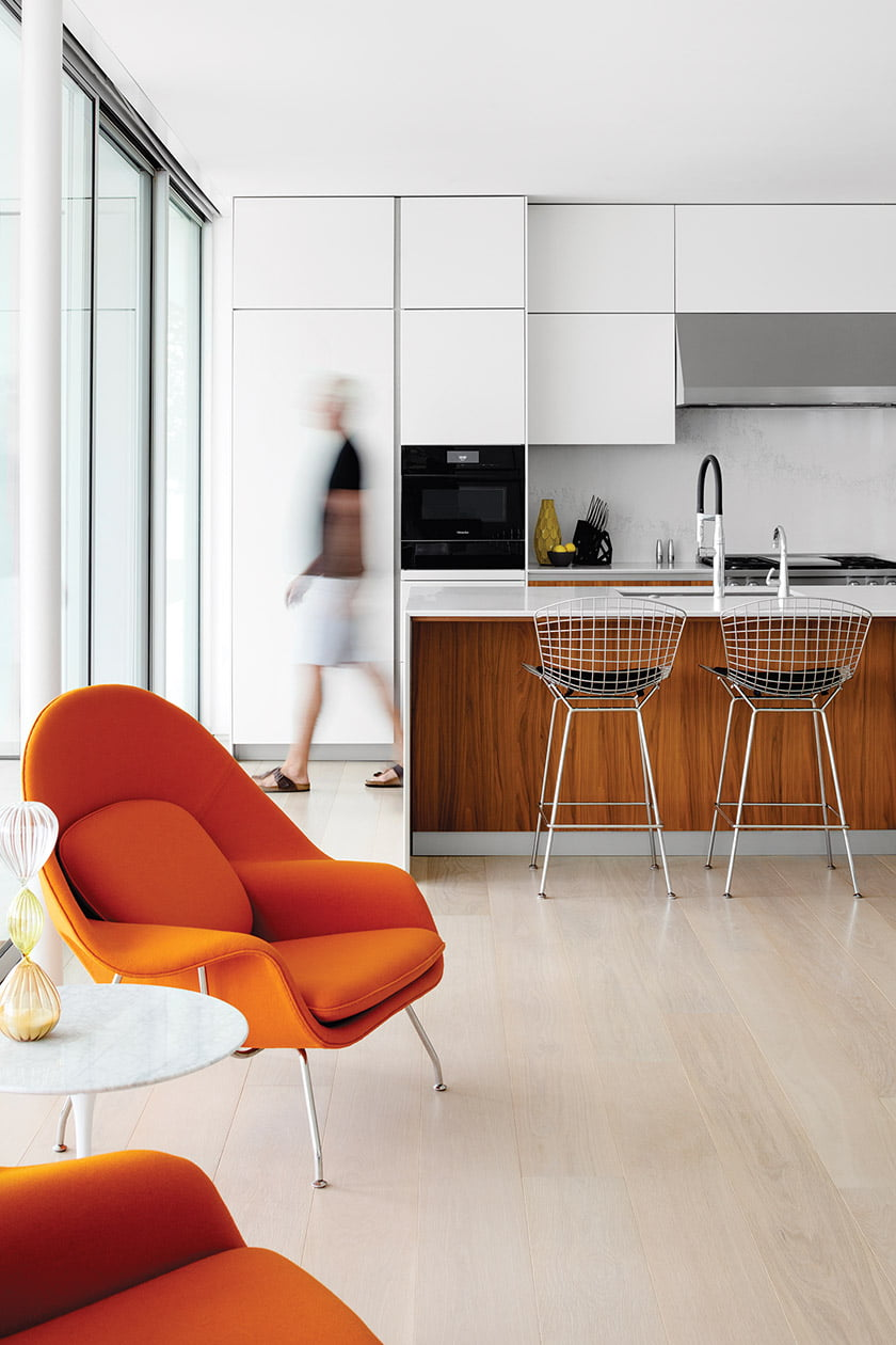 Bertoia bar stools line a Caesarstone-topped kitchen island