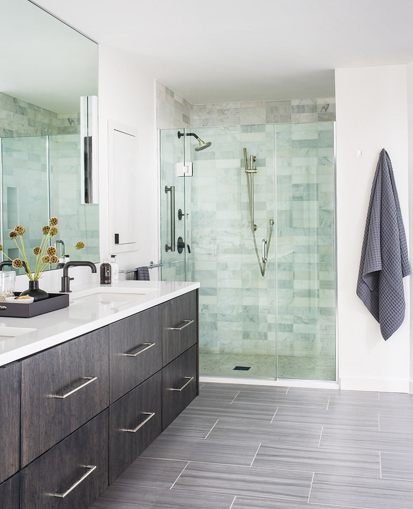 Owners bath with custom oak vanity and shower tile from Architessa