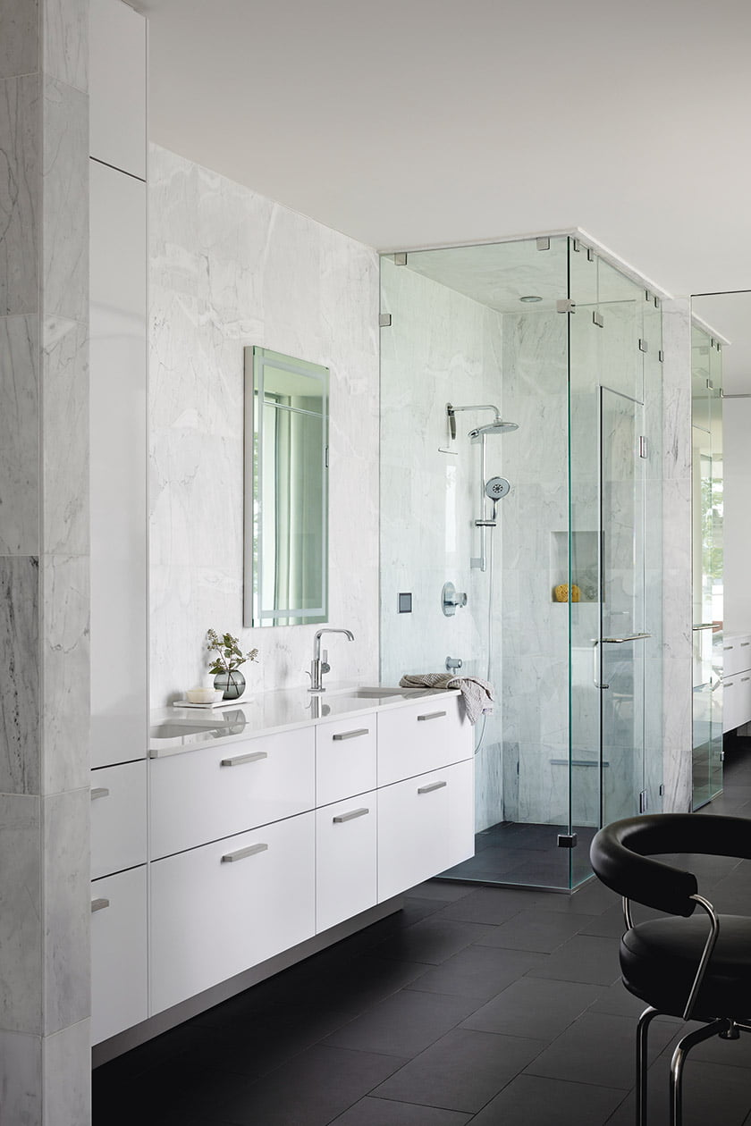 Owners bath with statuary marble wall tile from Best Tile and Grohe plumbing fixtures