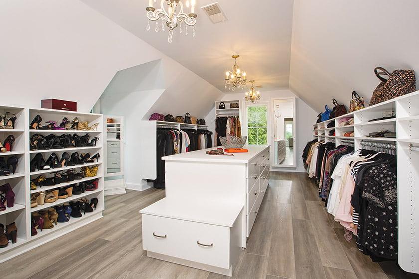 Bedroom suite walk-in closet with custom shelving