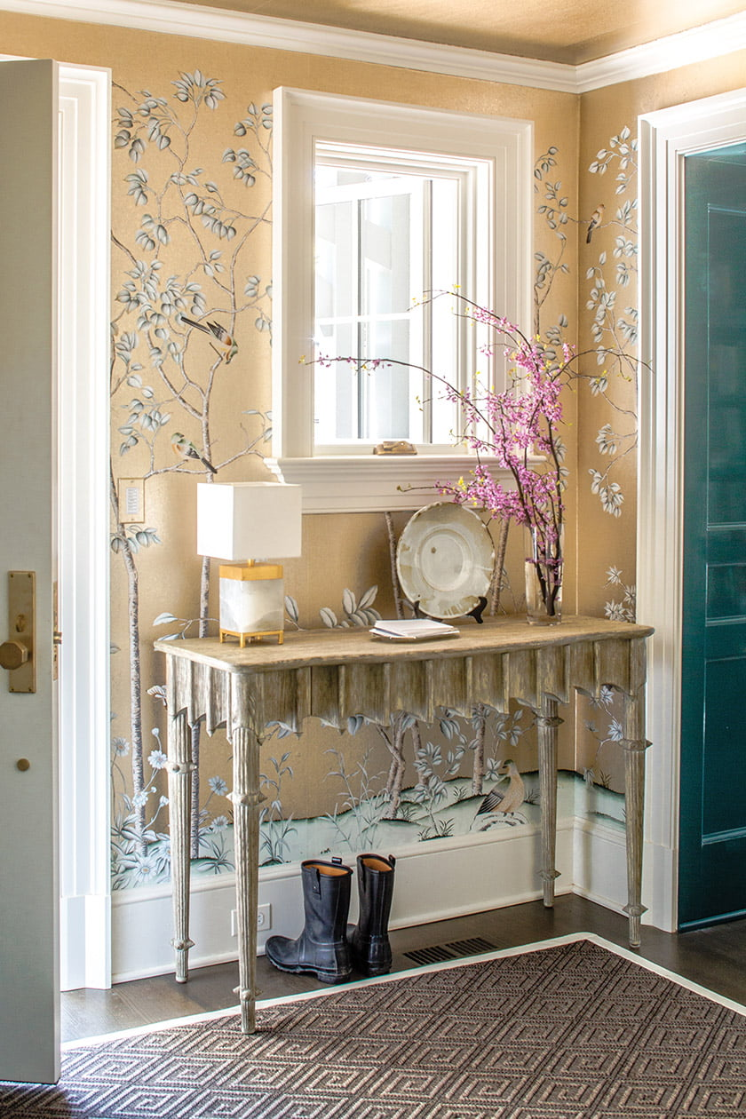 Wallpaper from Paul Montgomery Studio graces foyer walls and ceiling