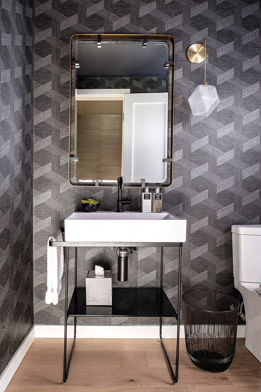Powder room with shimmery Philipp Jeffries wallpaper