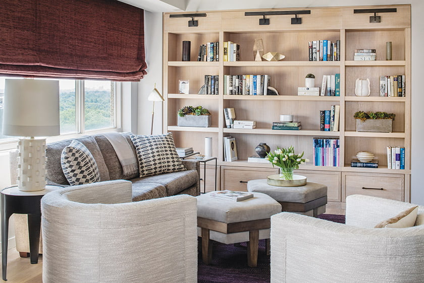 TV room with custom oak built-in and cozy furnishings