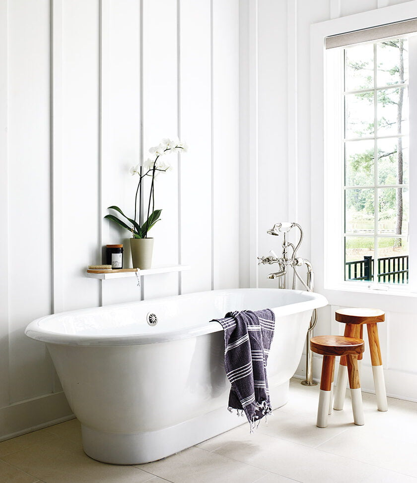 Waterworks soaking tub with board-and-batten wall panels