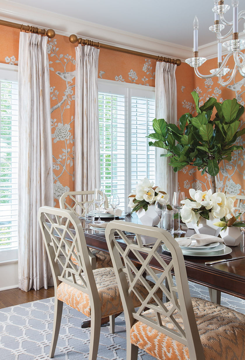 Bonnie Ammon designed the dining room with bright orange hues that evoke a feeling of happiness.