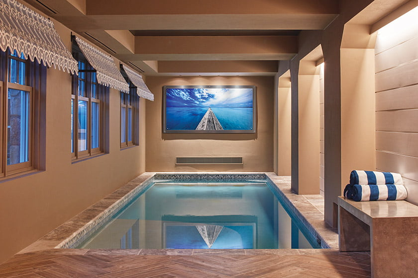 Indoor pool with porcelain-tile floor and plaster wall finish