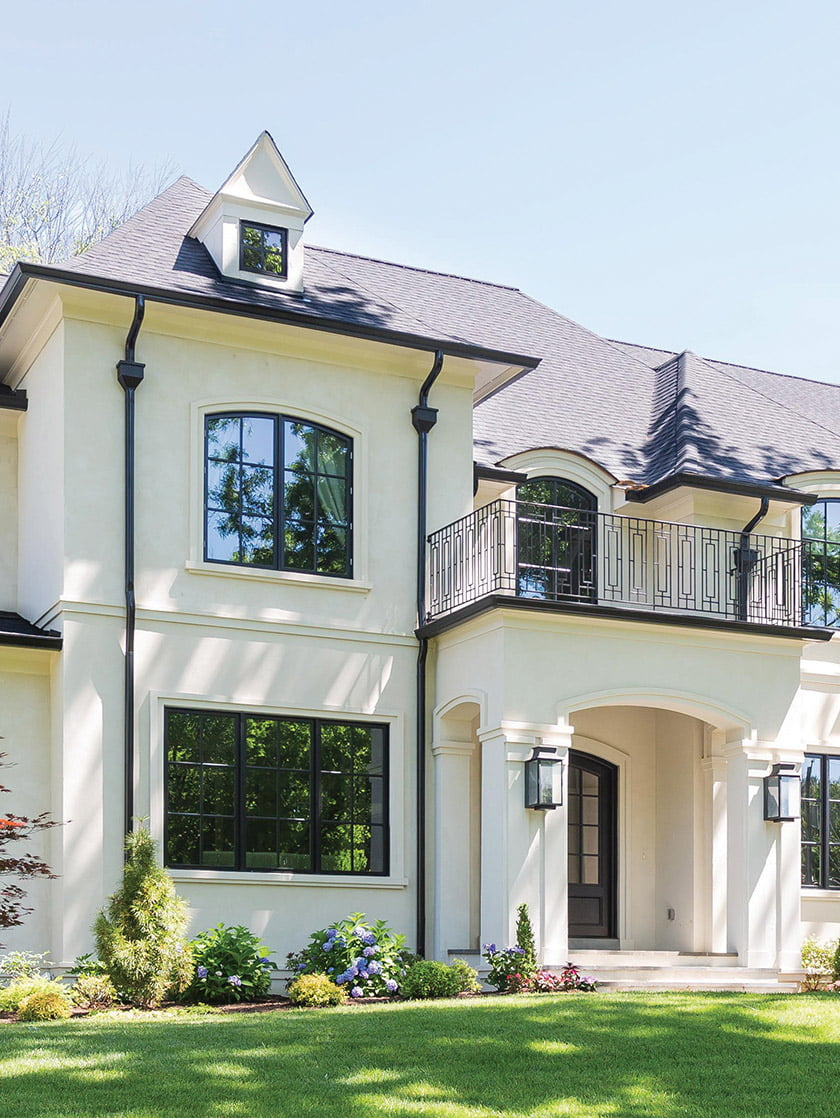 A custom home in McLean is enhanced by French architectural flourishes.