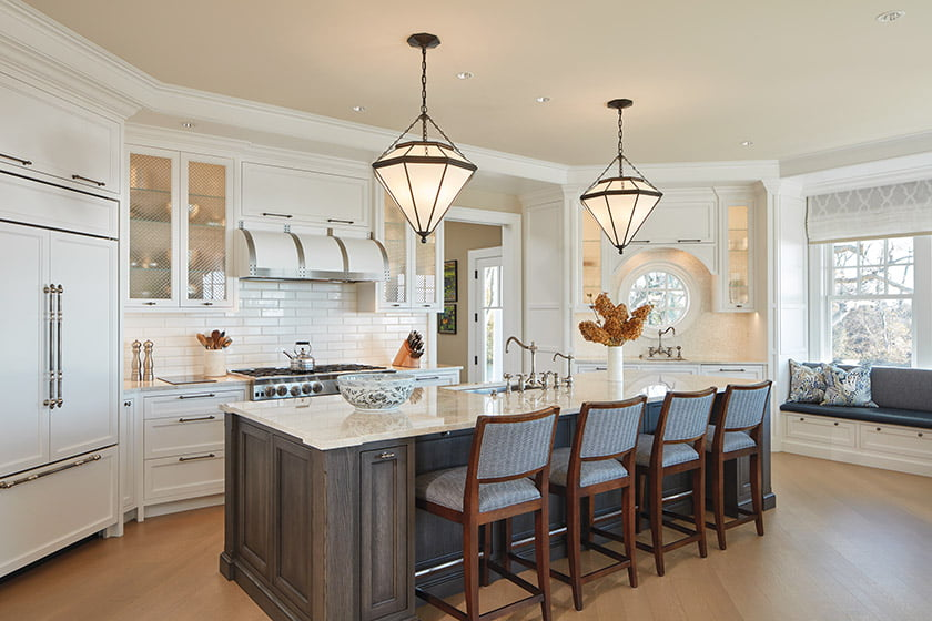 Kitchen with beverage bar and built-in banquette