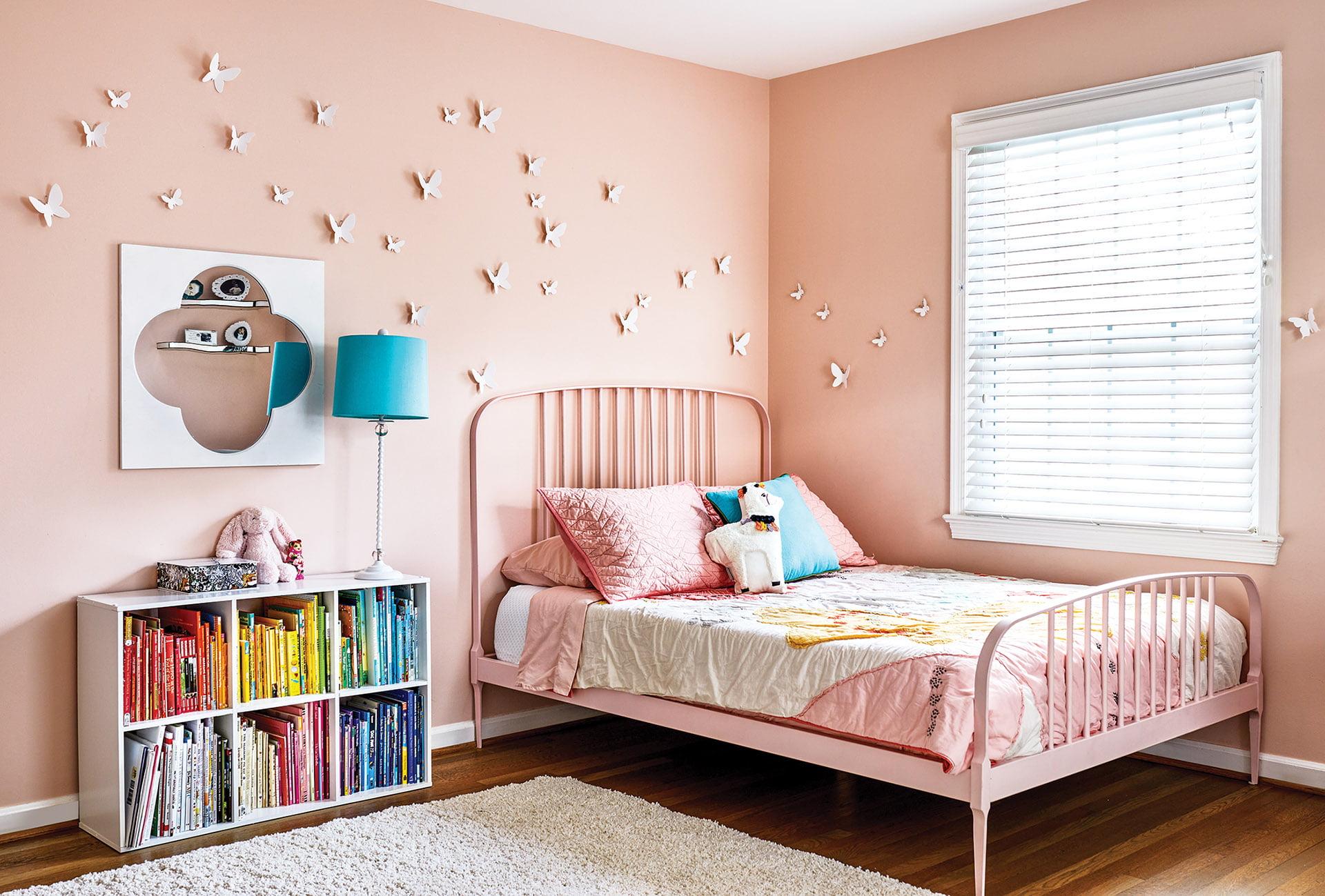 3D butterflies adorn walls painted in Sherwin-Williams Romance in girl's bedroom.