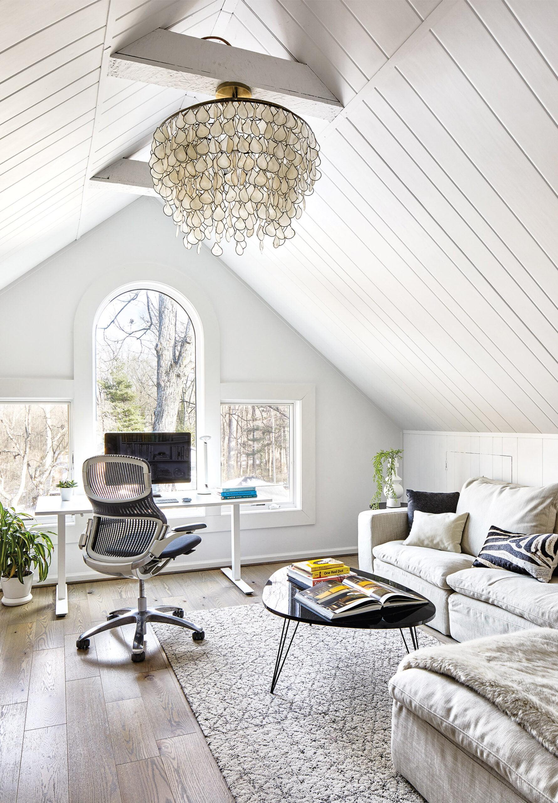 Home office, RH Sofa, Flor rug, Knoll task chair and adjustable-height desk.