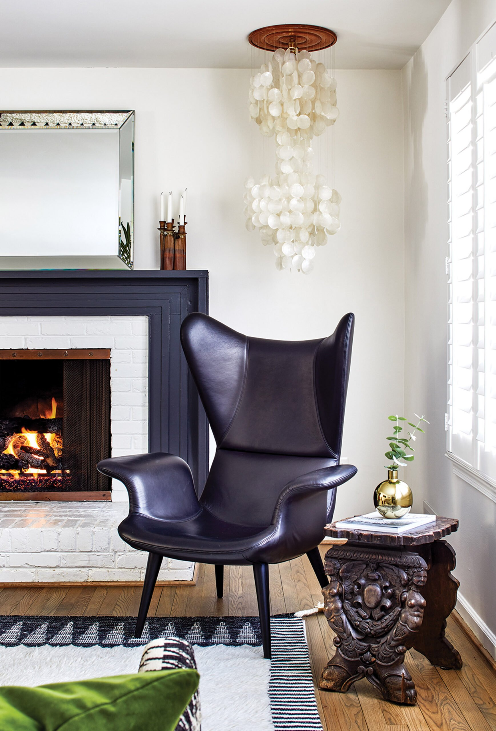 Living room, modern chair from Moroso's Diesel and 1860s European wedding stool.