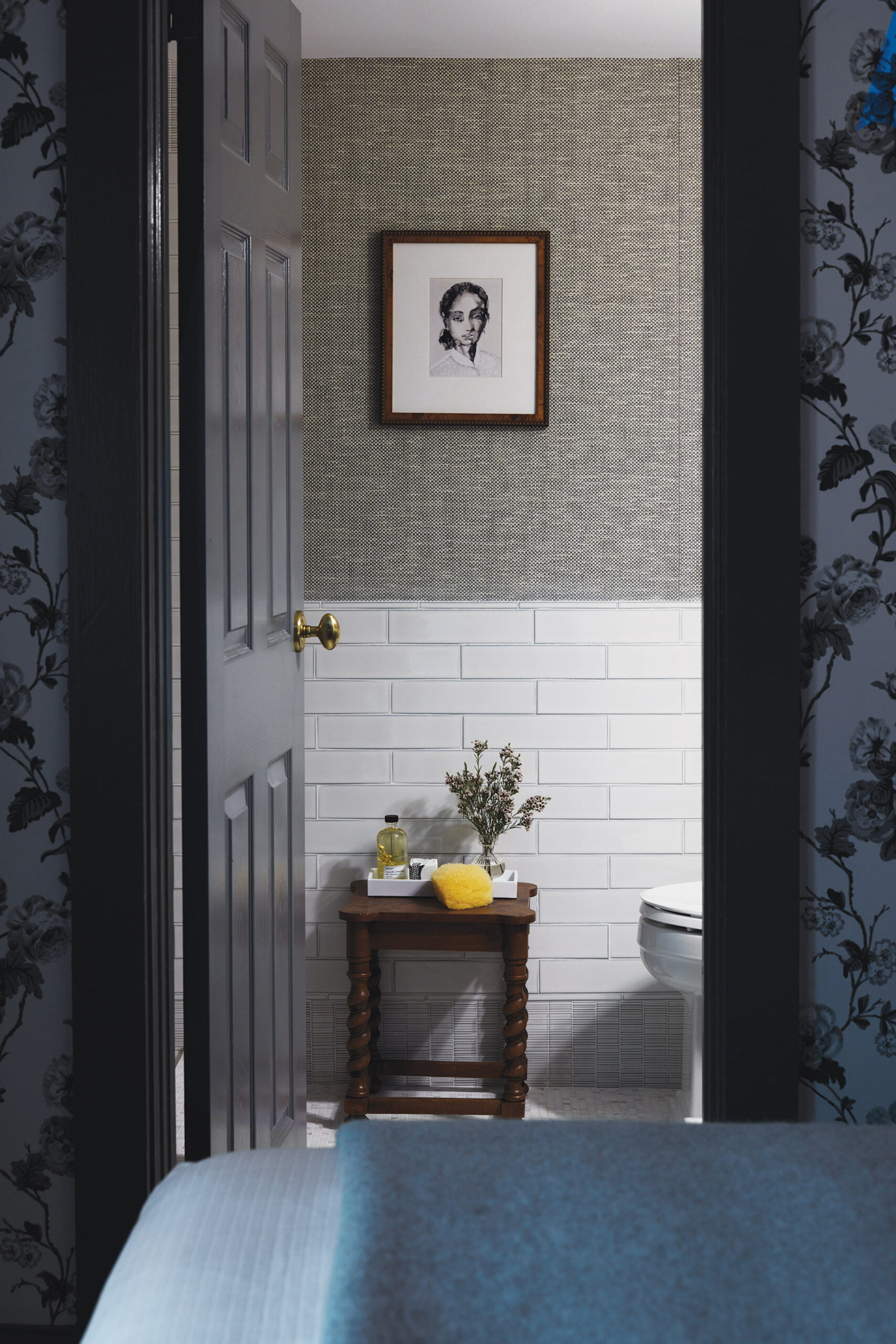 En-suite bath with Schumacher wallpaper and Ann Sacks subway and ribbed-mosaic base tile.