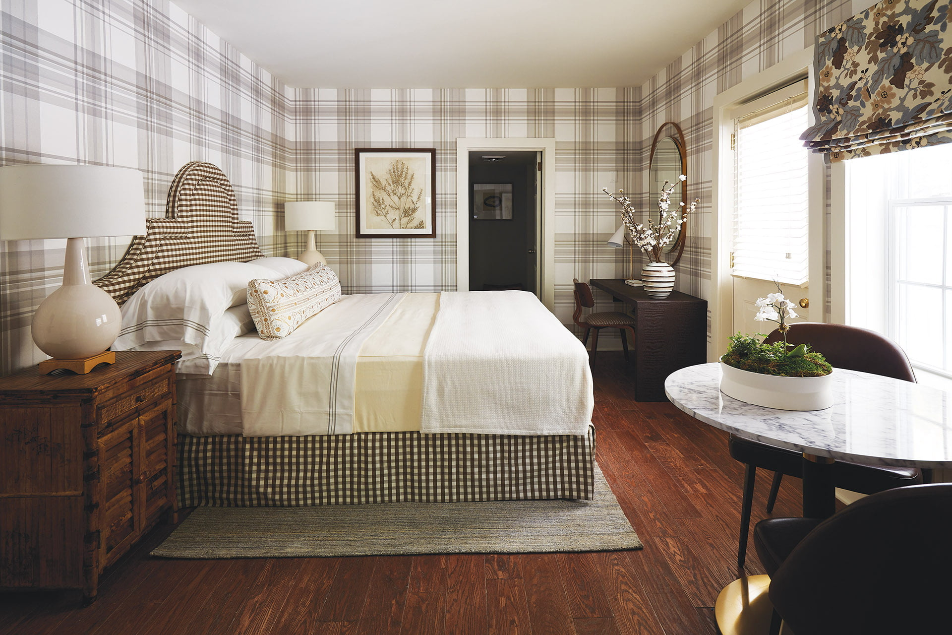 British style bedroom with checks and plaids dominating a floral window shade.