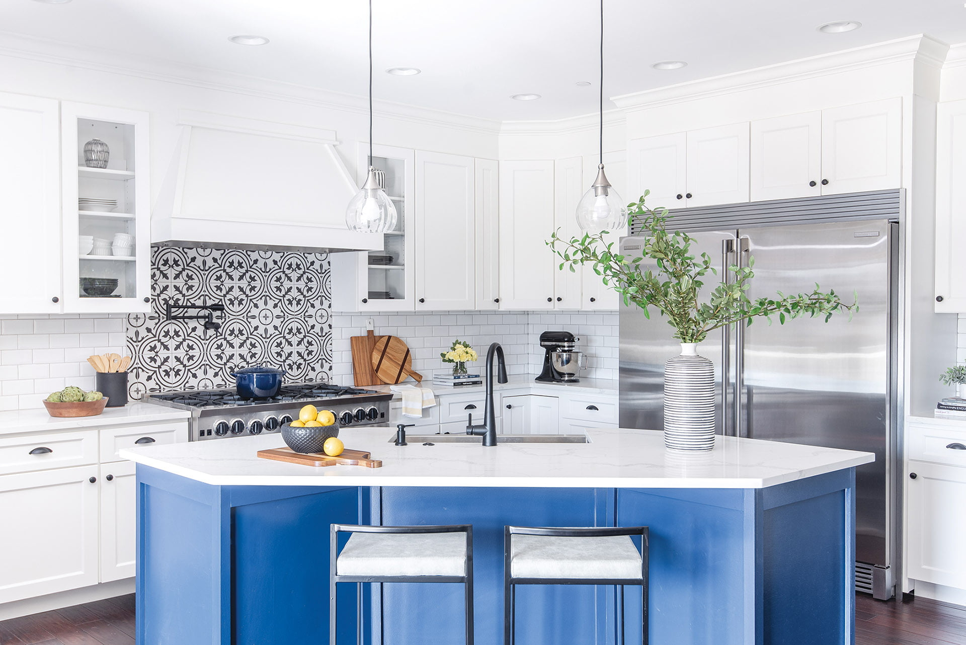 Kitchen with ceramic tile and island painted in Sherwin-Williams Salty Dog