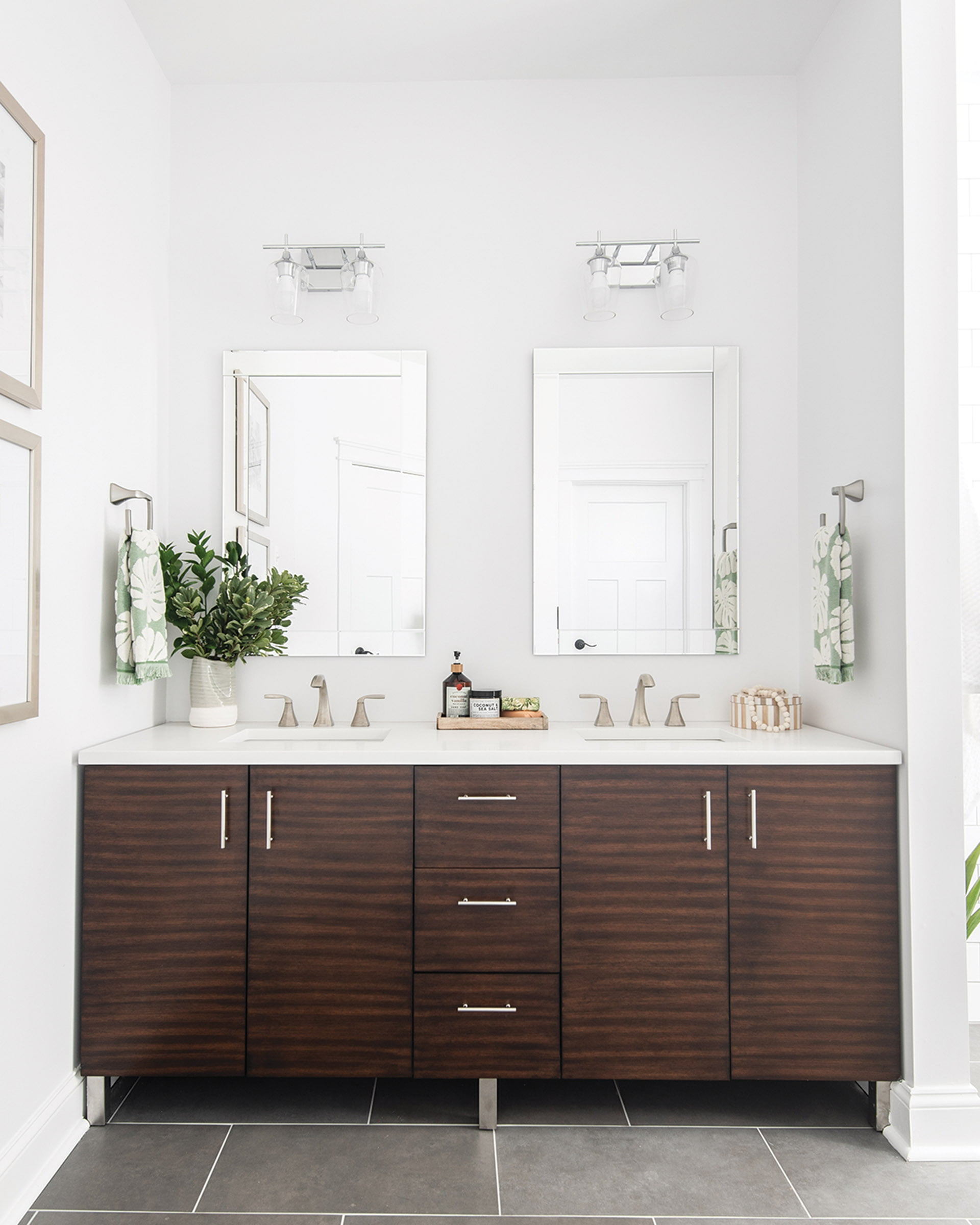 Bath boasts a wooden vanity and a porcelain floor
