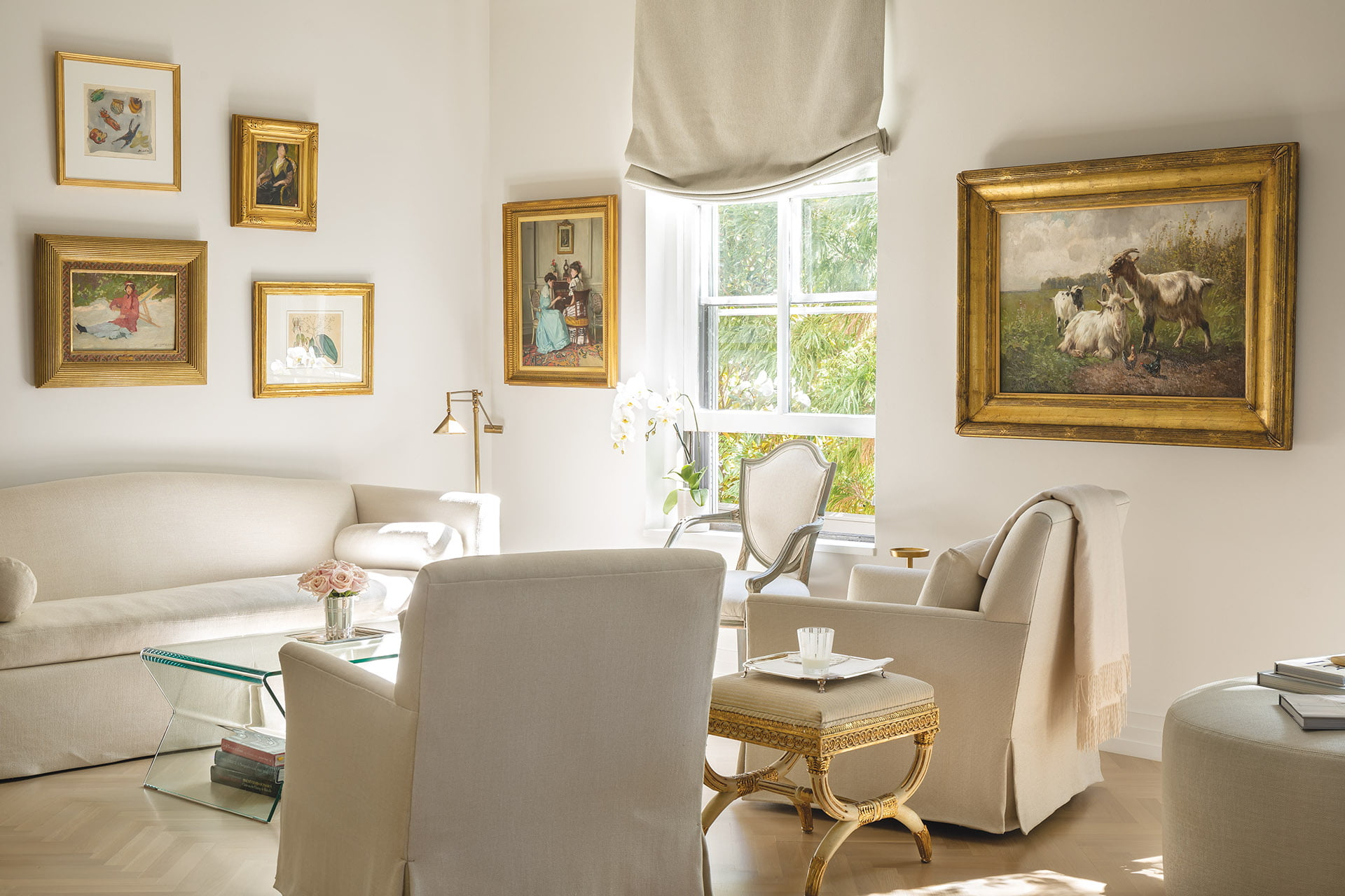 Martens grouped small, gilt-framed paintings salon-style on the wall above a Ferrell Mittman sofa in living area