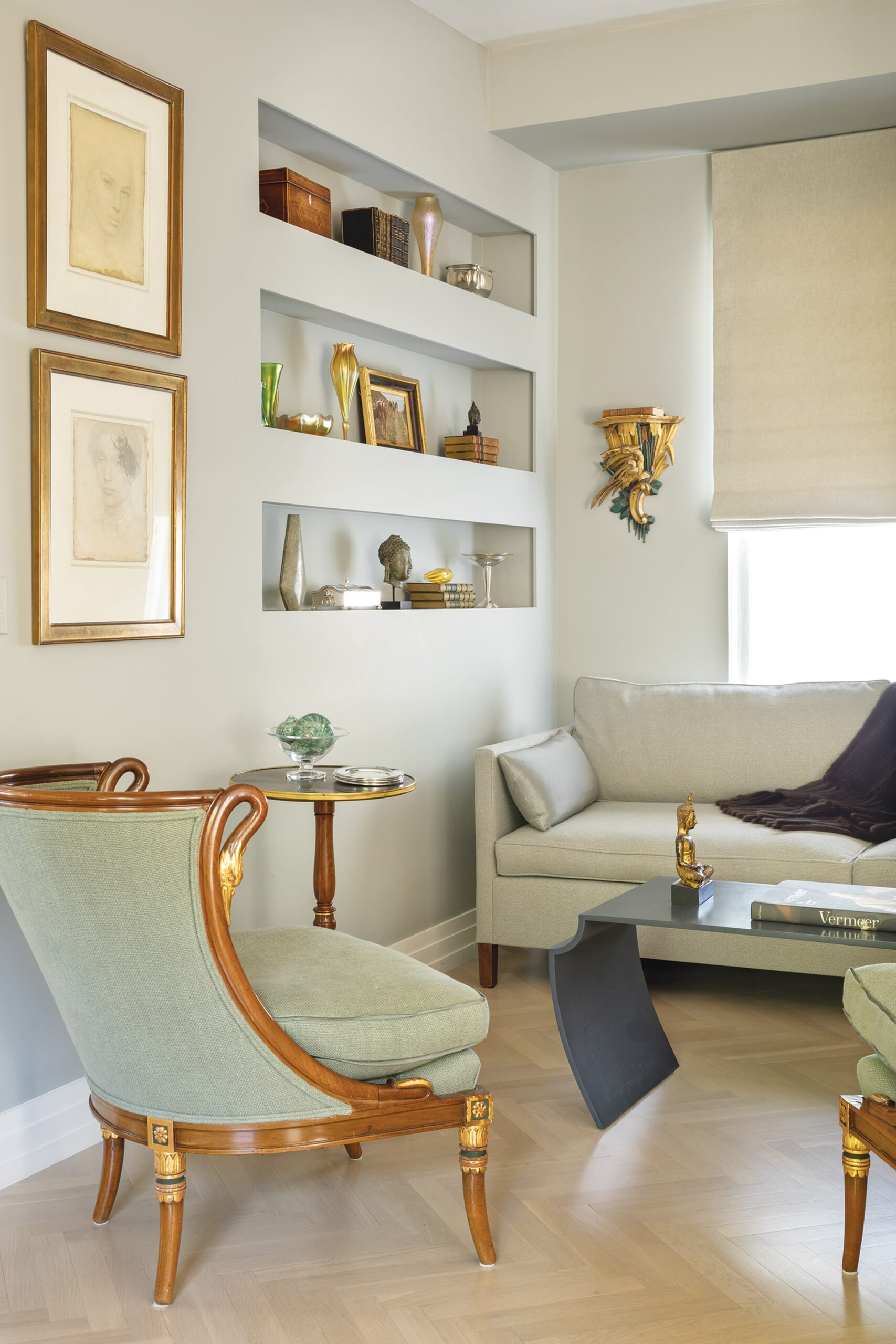 Sitting area with linear shelves, Dessin Fournir sofa and Louis Philippe wood-framed chairs