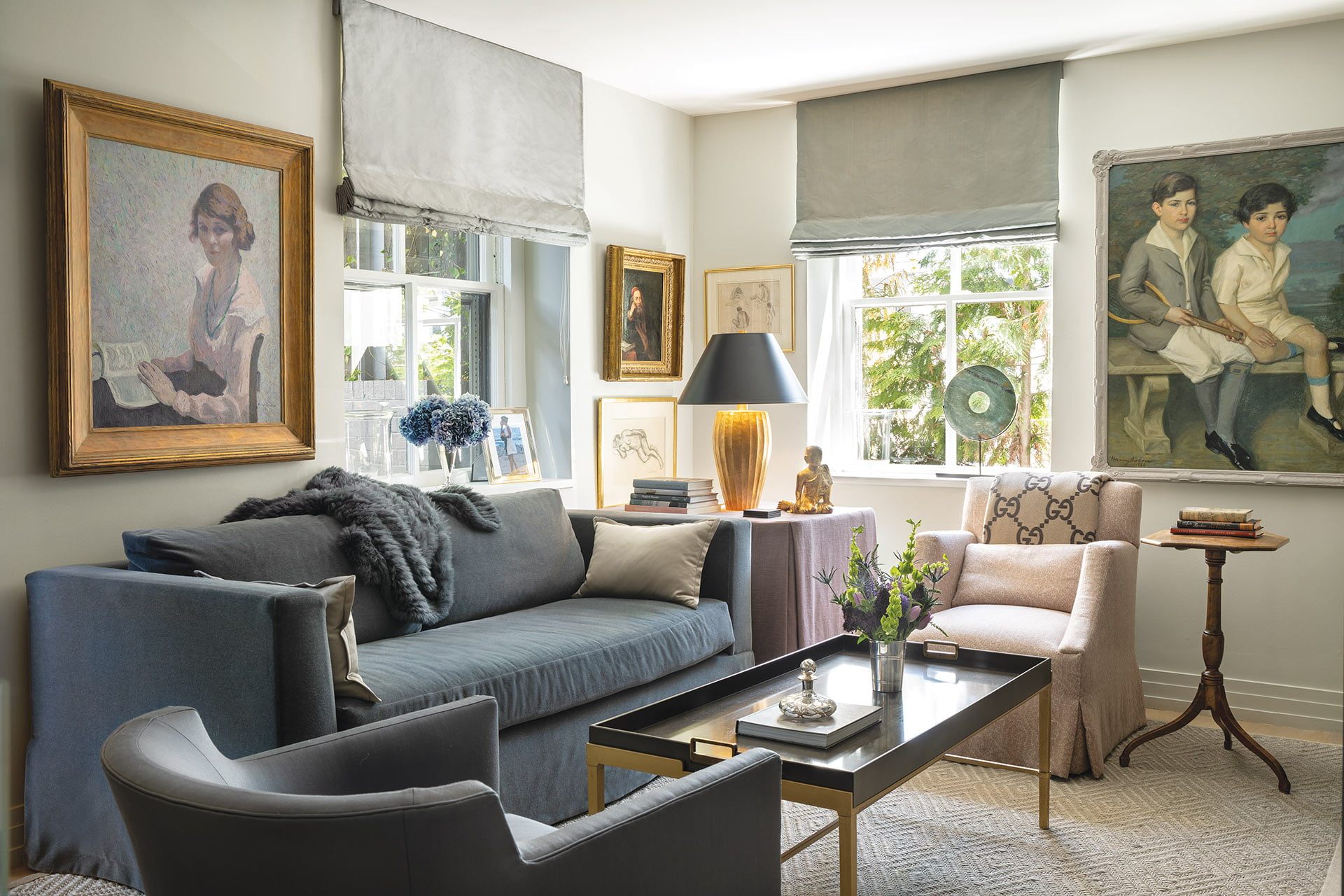 Dark-gray custom sofa in the study, and Hickory White coffee table and comfortable armchairs are grouped atop a sisal rug.