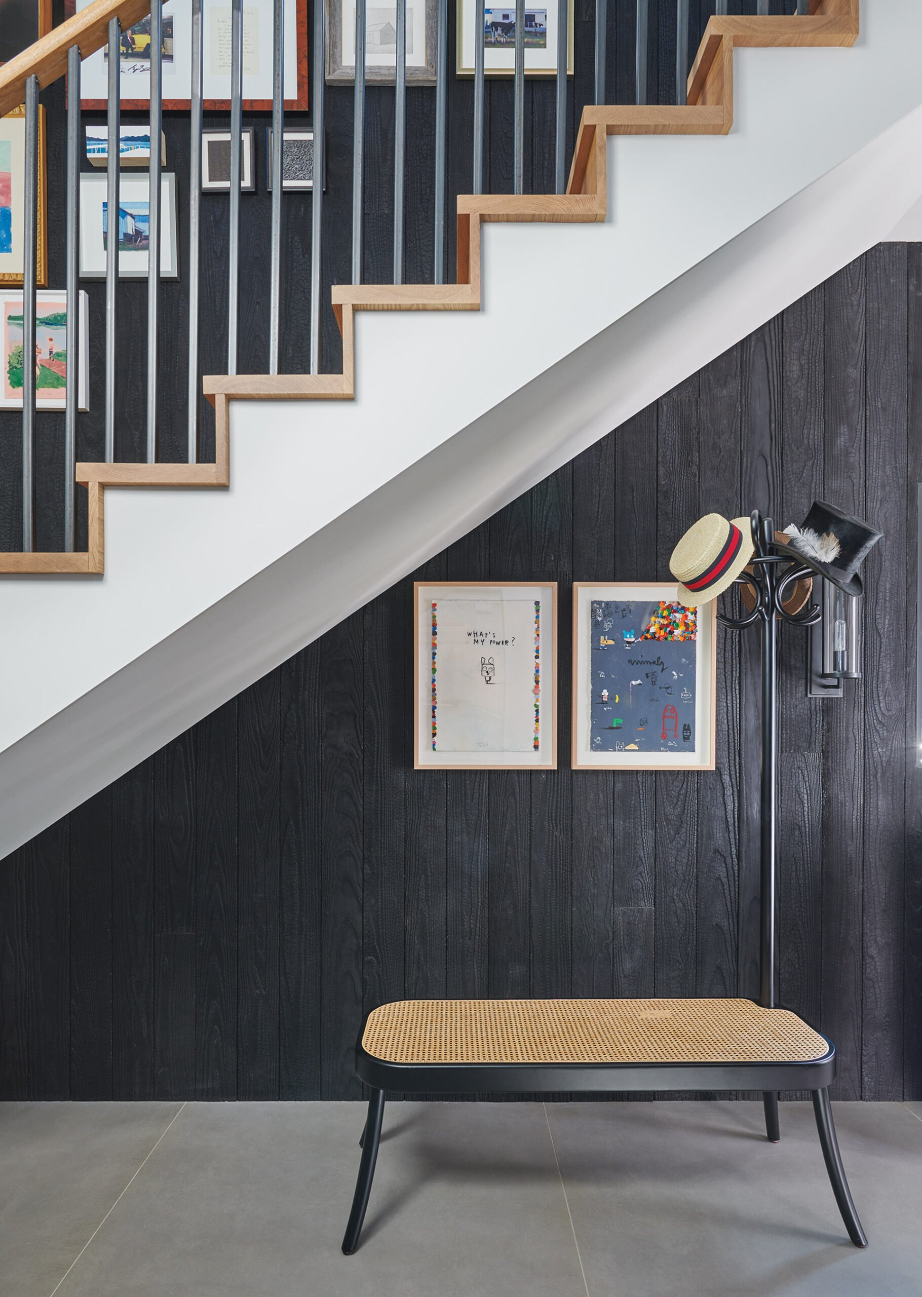 Guest house, wood accent wall features Japanese shou sugi ban finish.