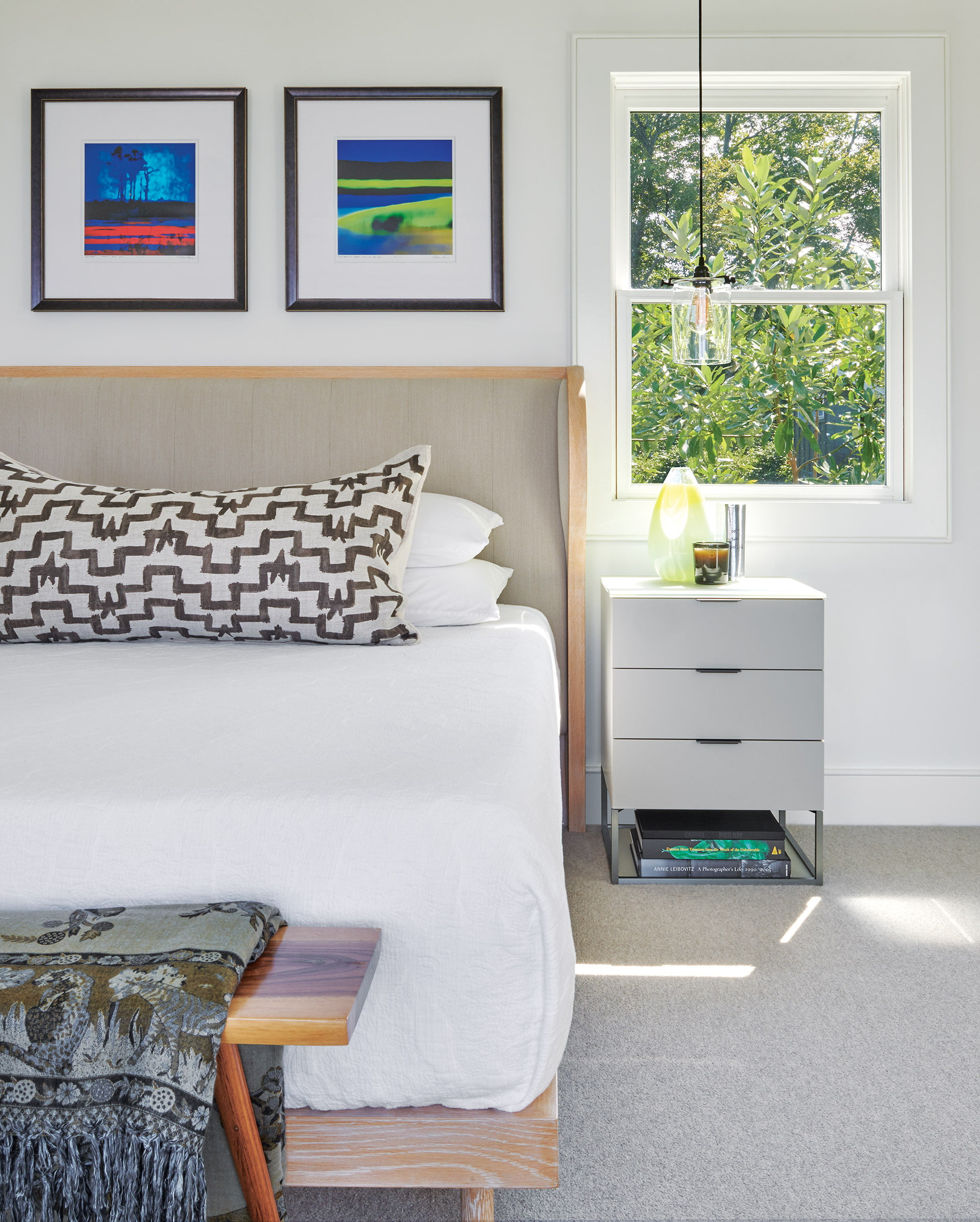 Primary bedroom has gray-washed pine bed from Daniel Donnelly Modern Design.