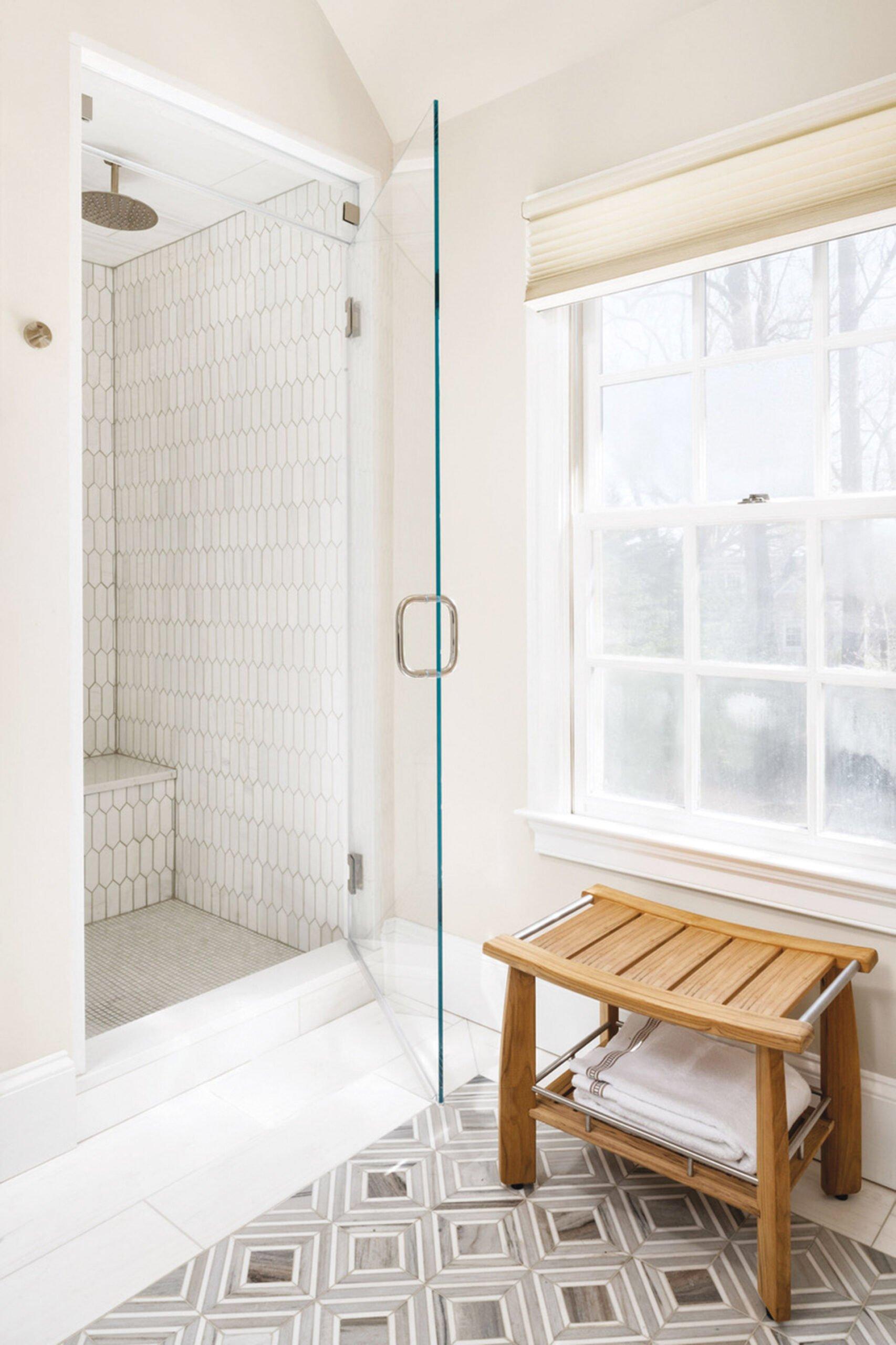 Shower stall in white tile.