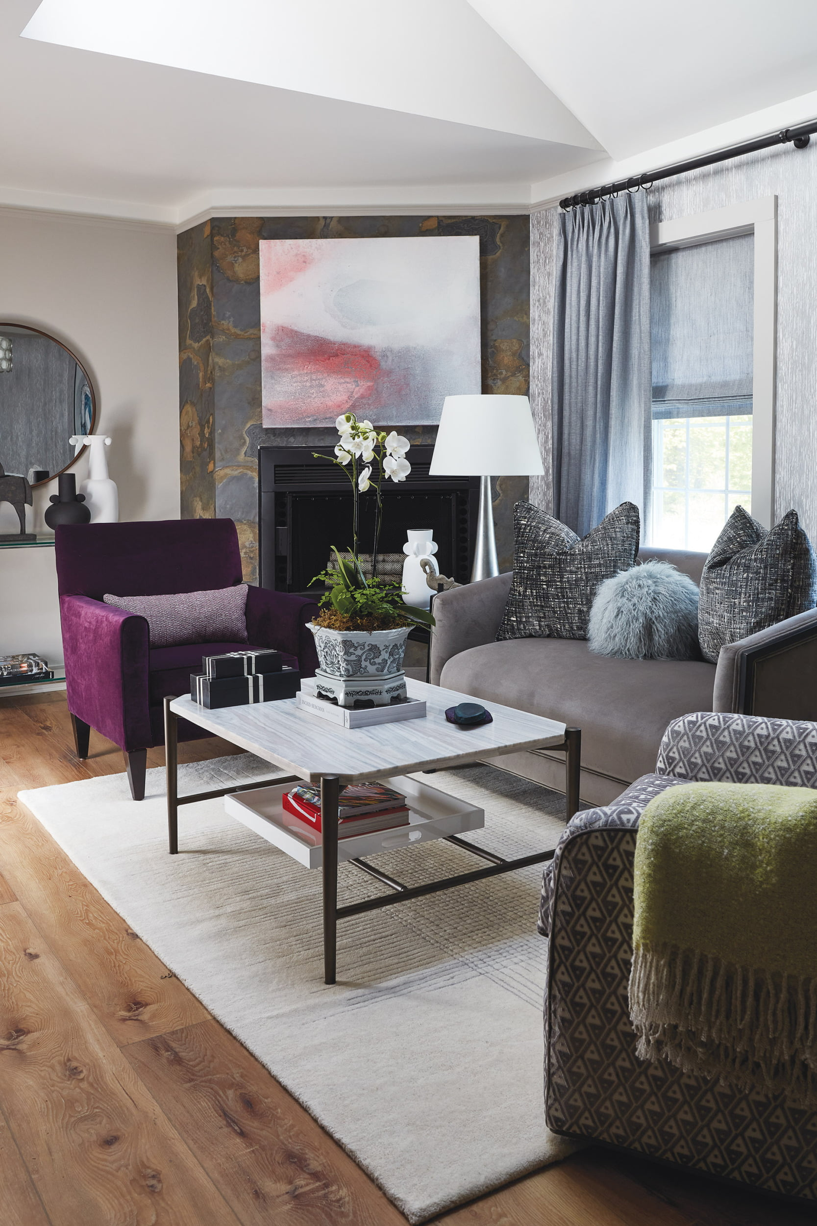 Chic and serene living room. Weitzner wall covering, custom chair in deep violet