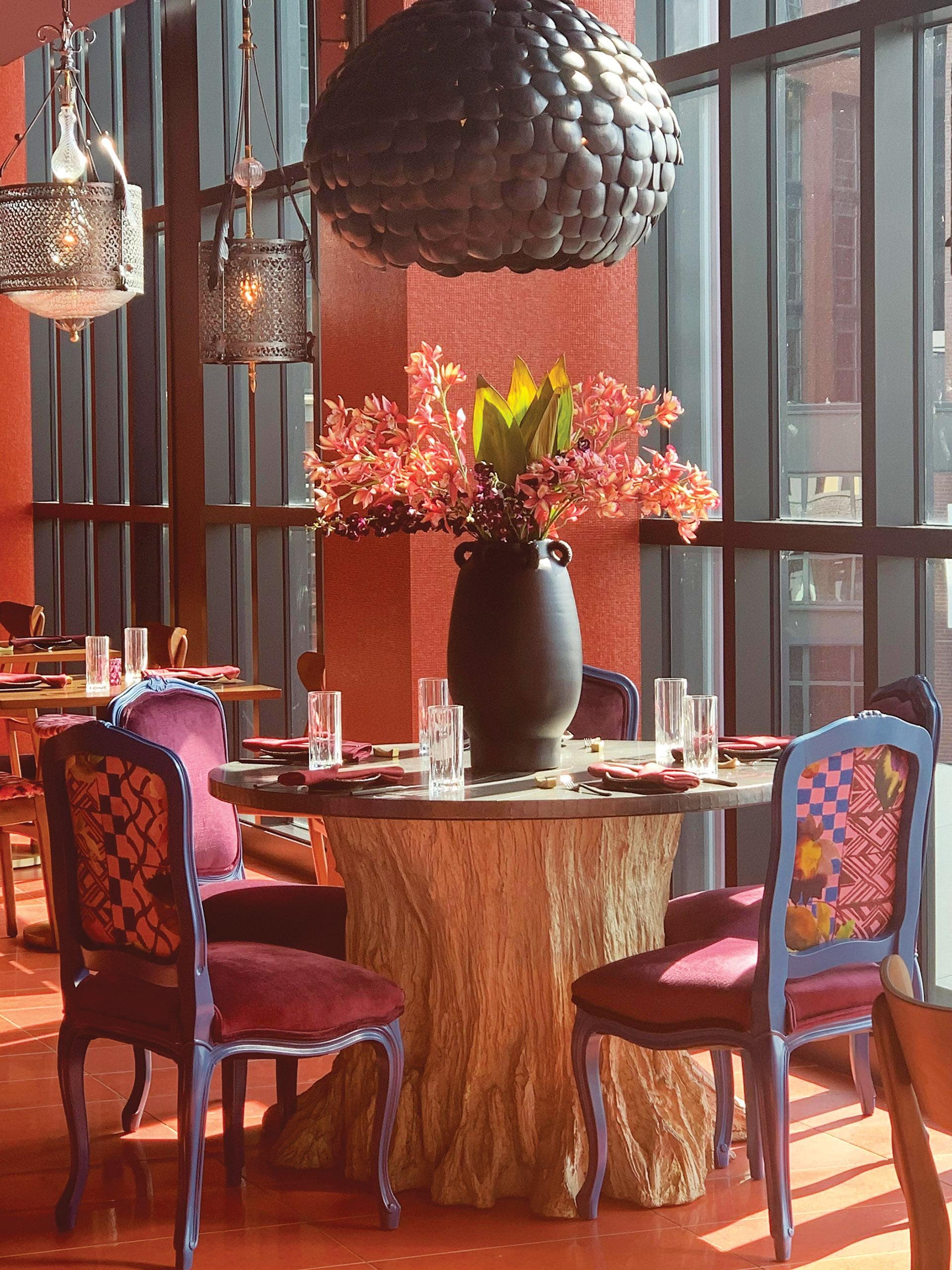Nara Ya VIP table boasts a faux bois base and a zinc top.