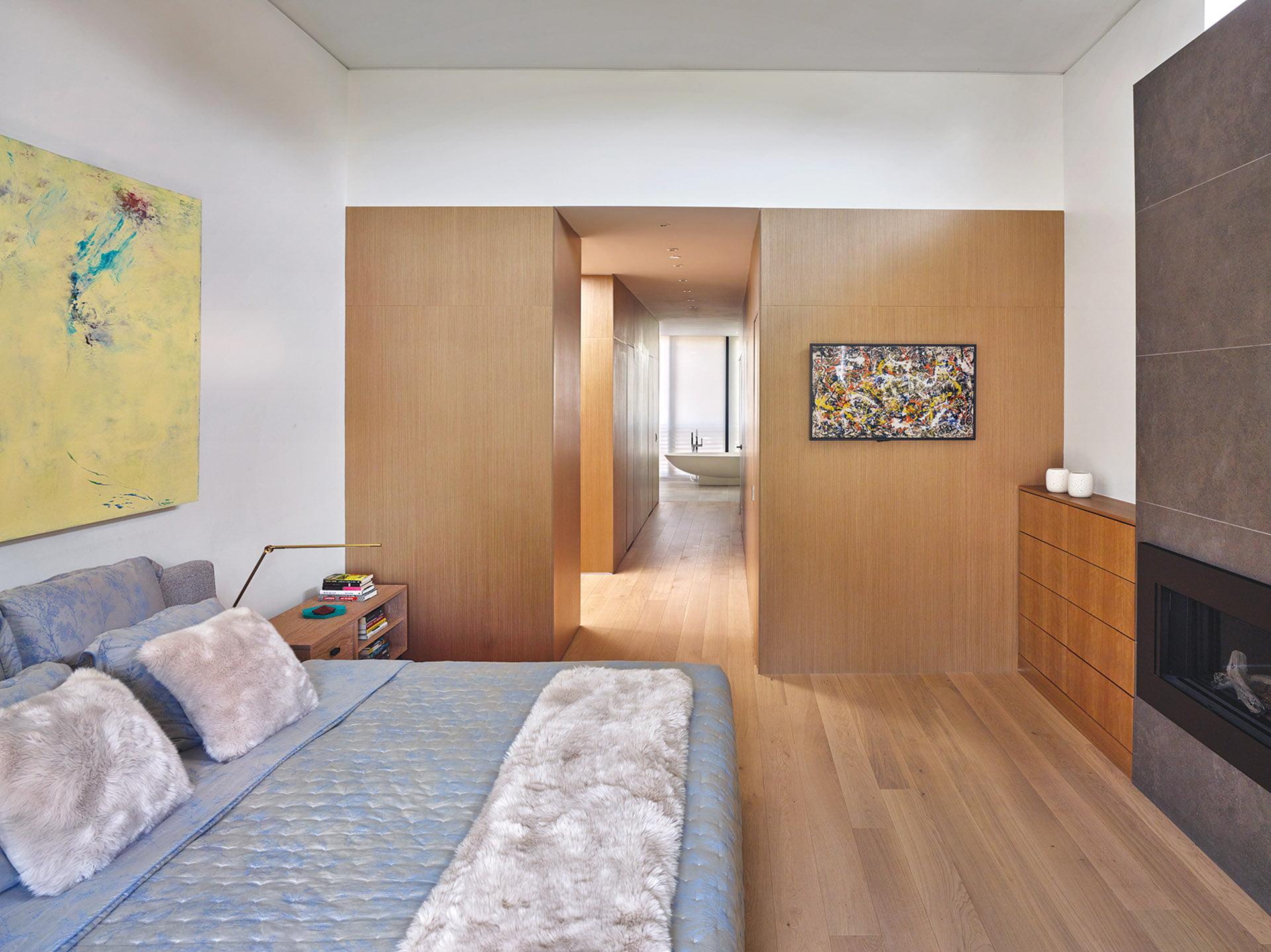 European white oak paneling bedroom walls, clerestory windows.