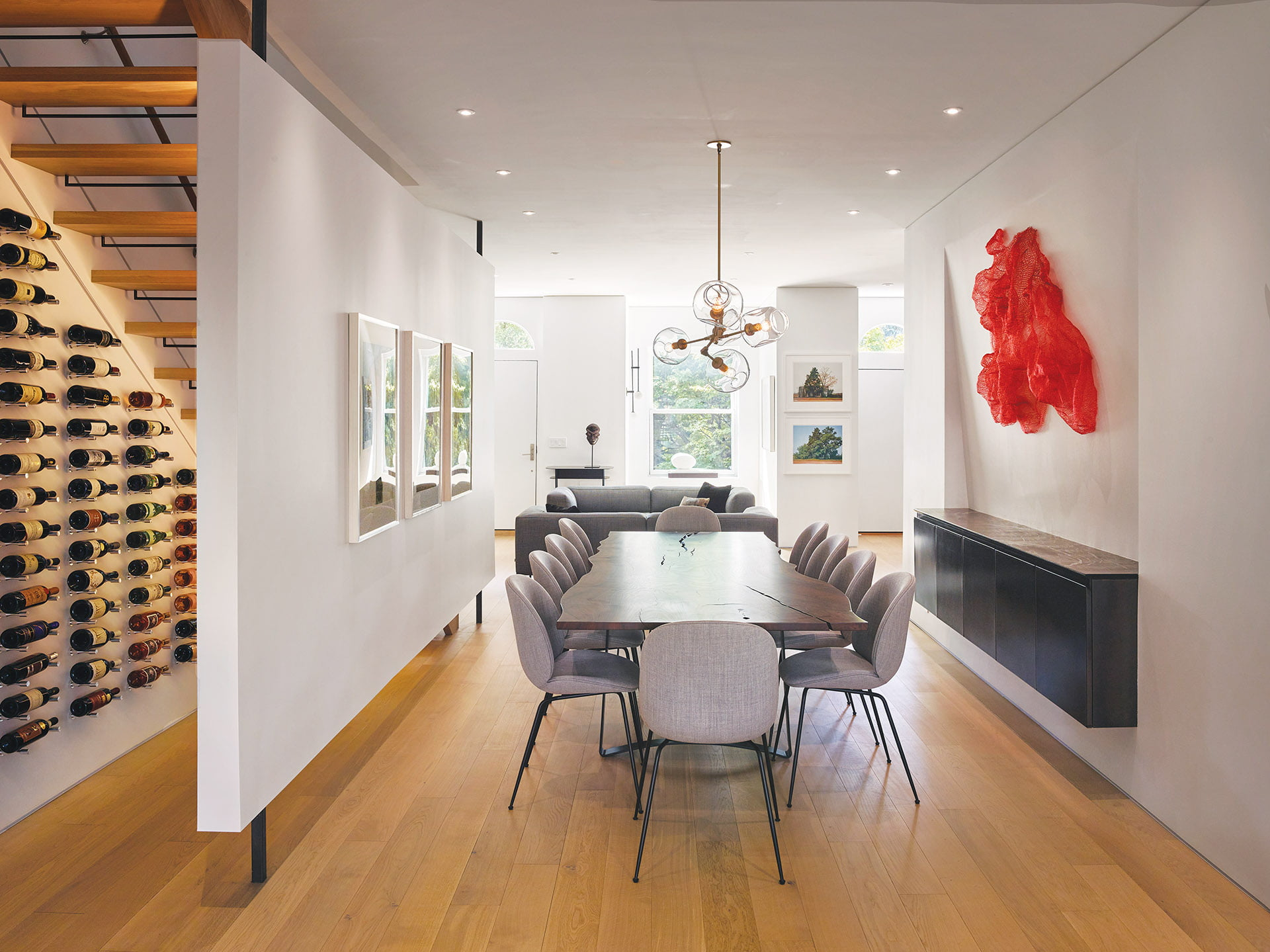 Custom dining table by Thos. Moser, floating partition conceals staircase and a wine wall.