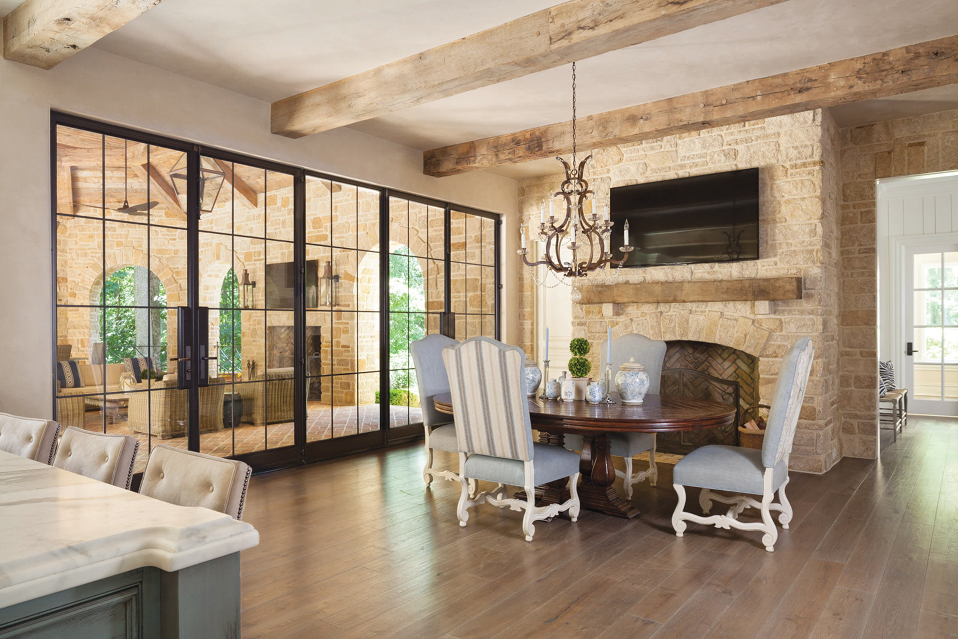Adjacent breakfast room connects to the loggia.