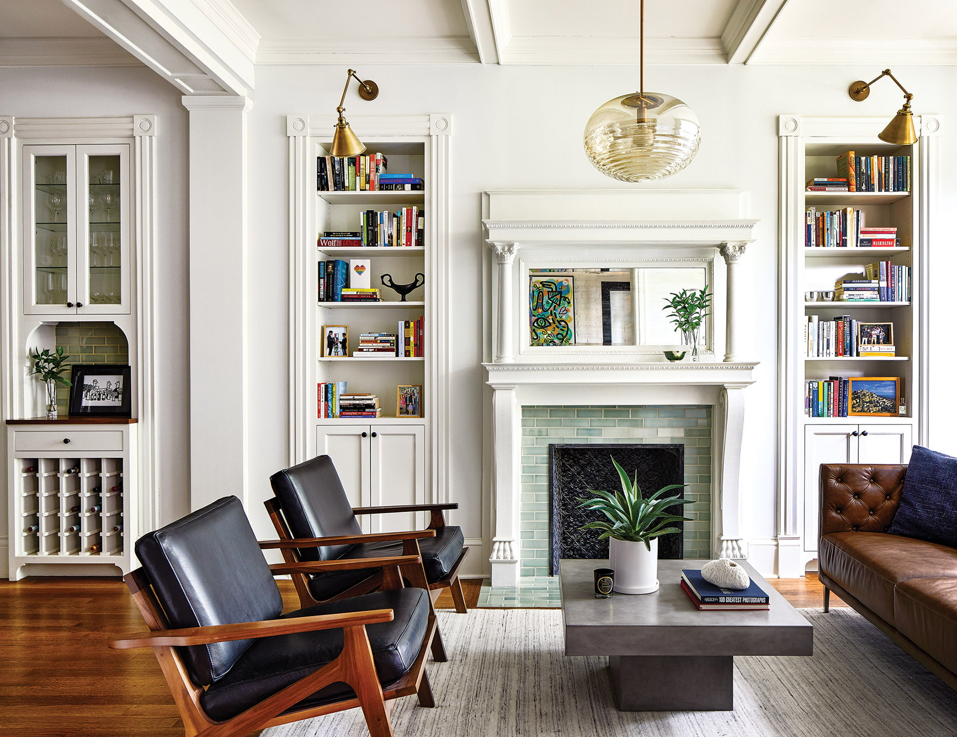 Built-in bookcases, pilasters, an elaborate mantel and tile surround in a the living room
