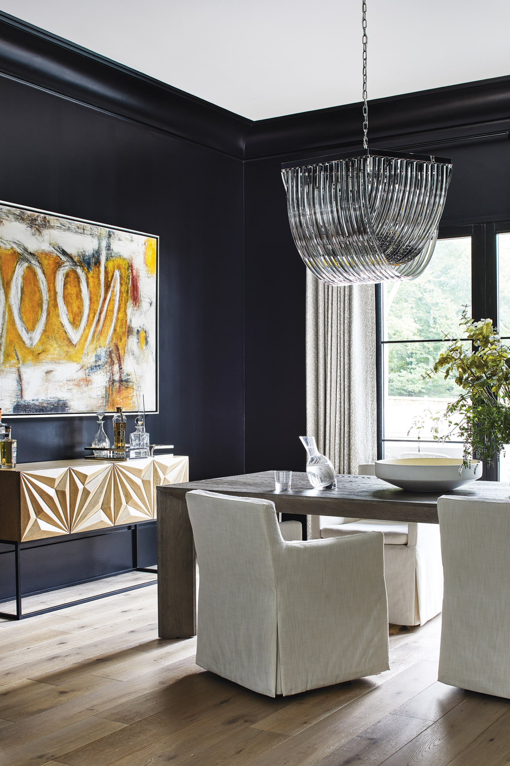 Sideboard from Noir LA in the dining room. The table and chairs are from RH.