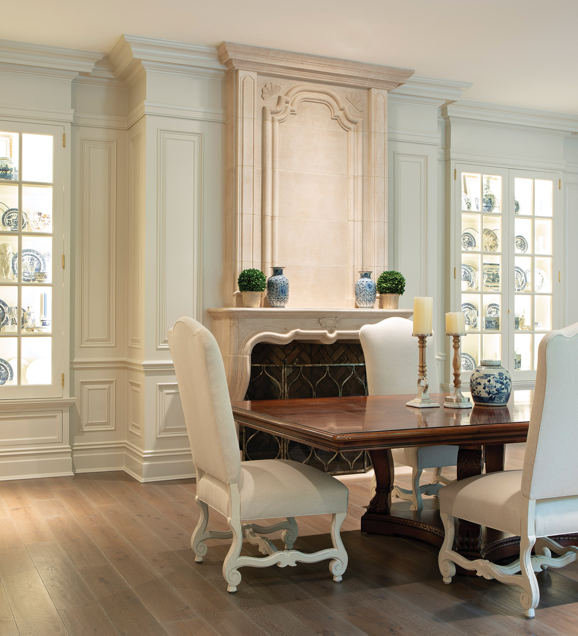 Dining room displays china collection in glass-fronted cabinets.