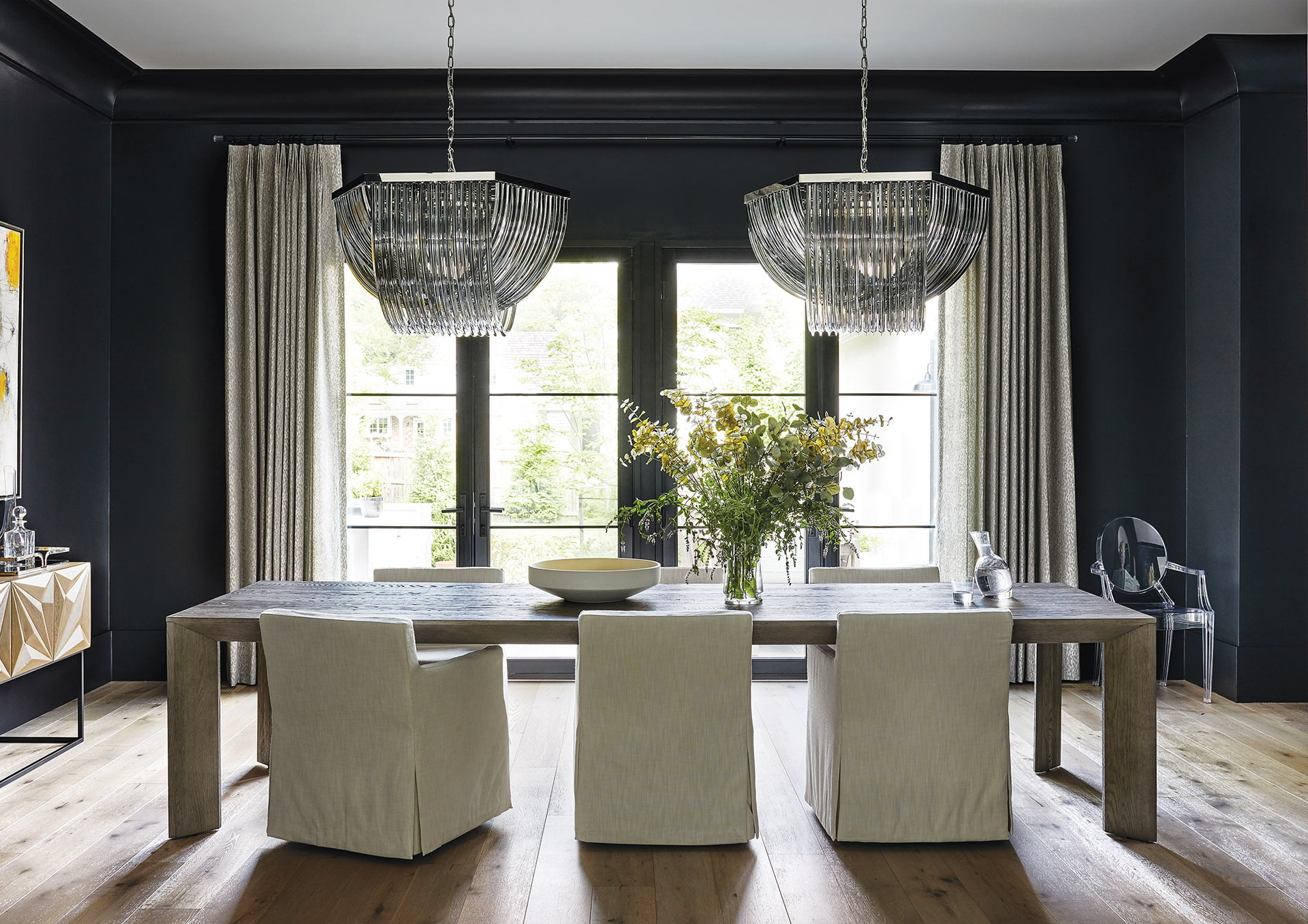 Dining room chandeliers from Sunpan and Jeffrey Alan Marks draperies.