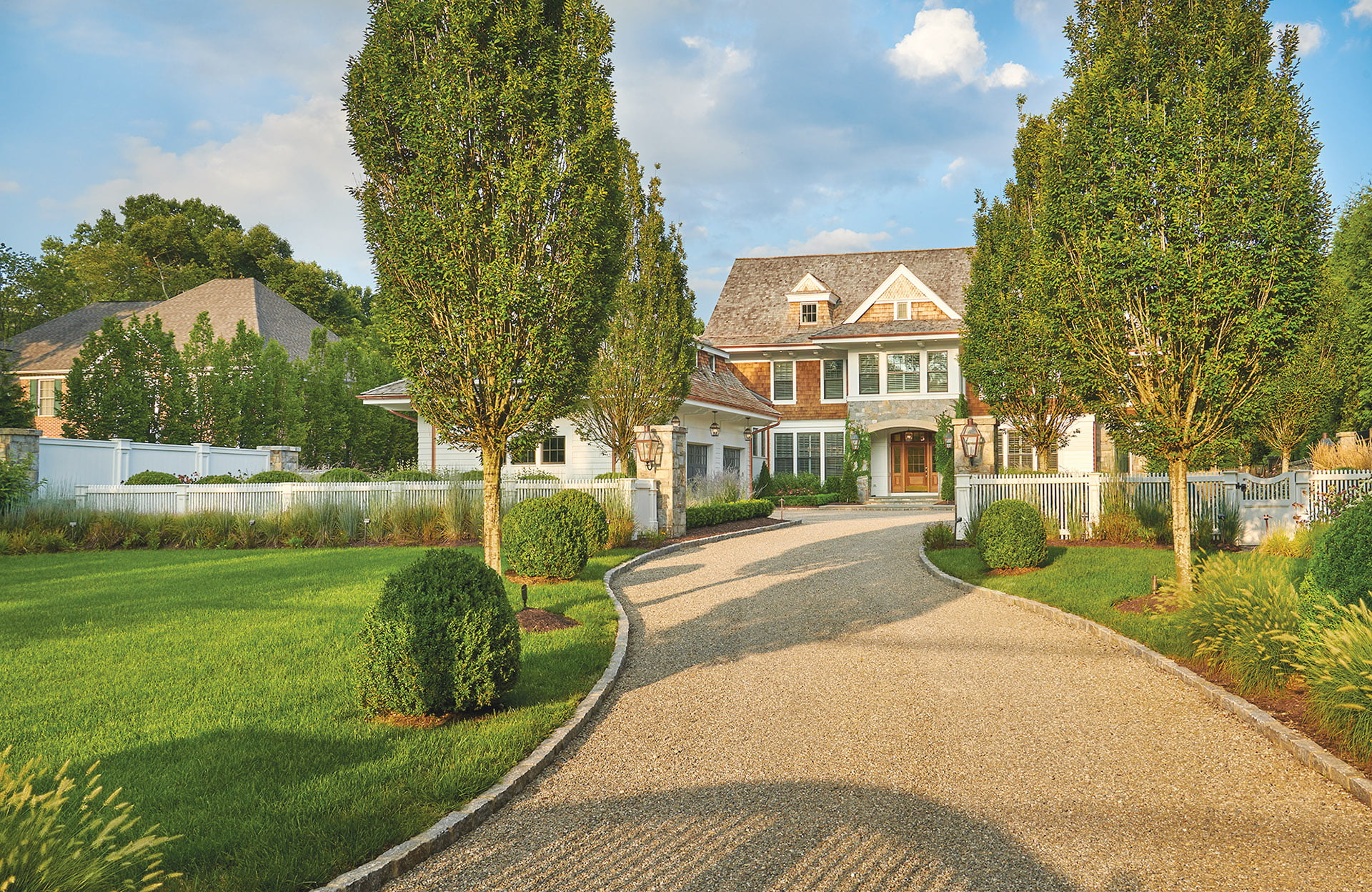 Surrounds, Inc., driveway made of Delaware Valley River Jack stone bordered by granite cobblestone.