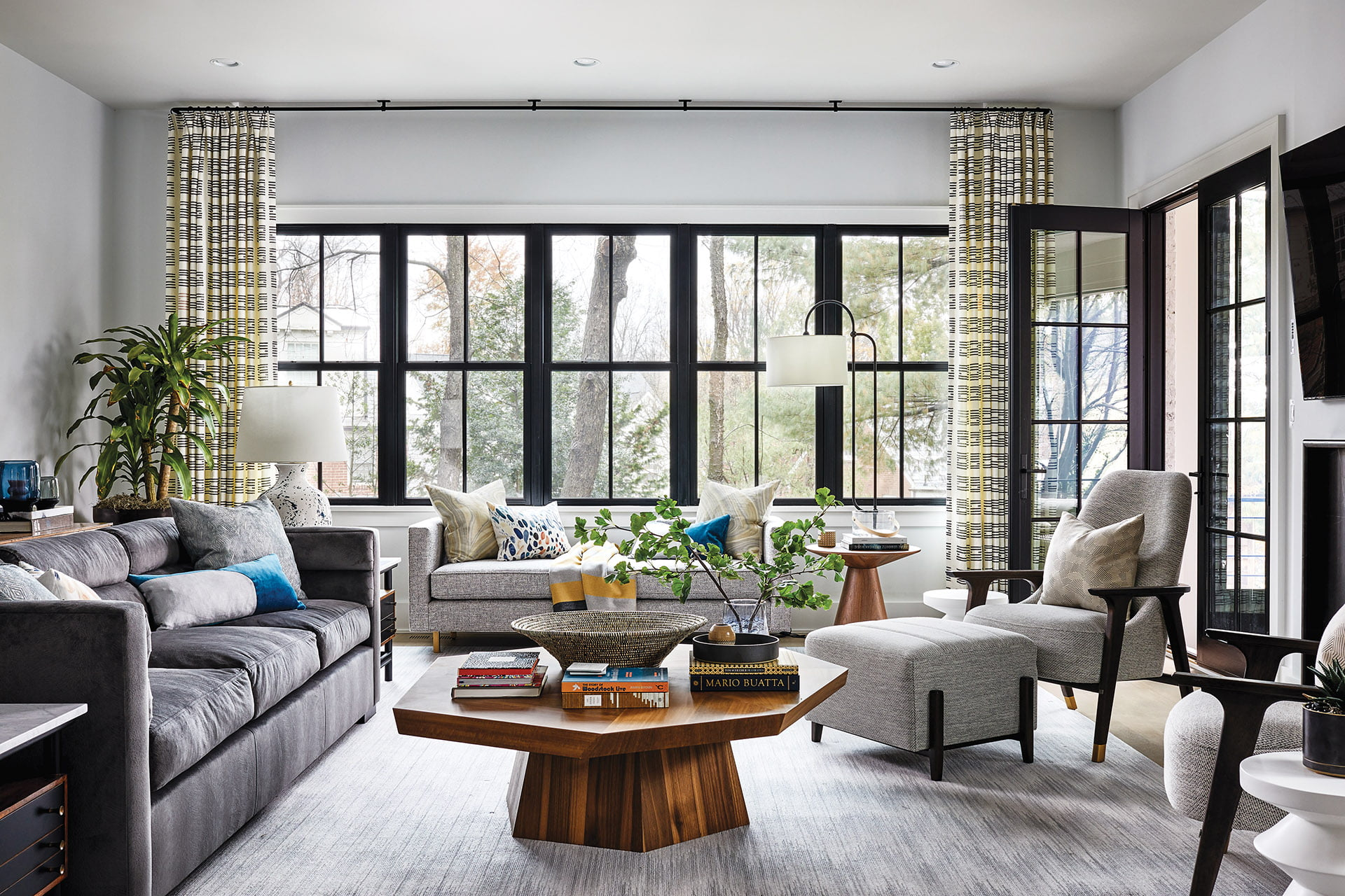 Great room, gray sofa and armchair from Peyton Home and low-backed Mitchell Gold + Bob Williams sofa