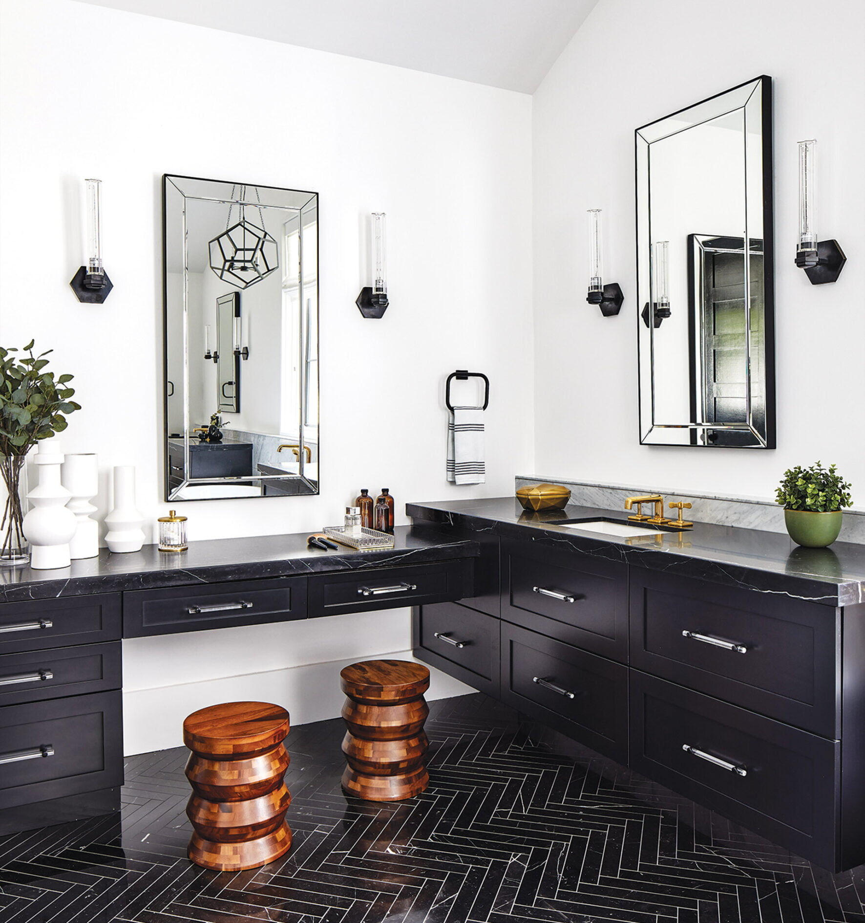 Owners bath, floating his and her vanities are painted glamorous black.