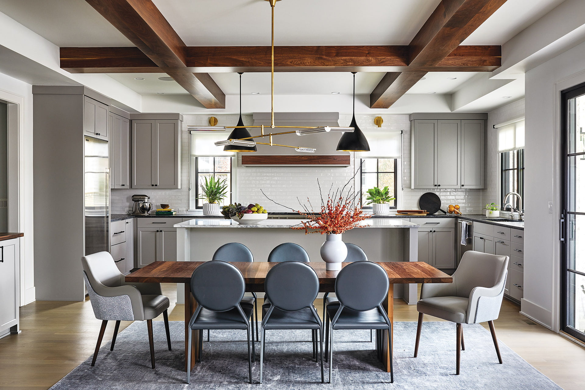 Visual Comfort chandelier above dining table