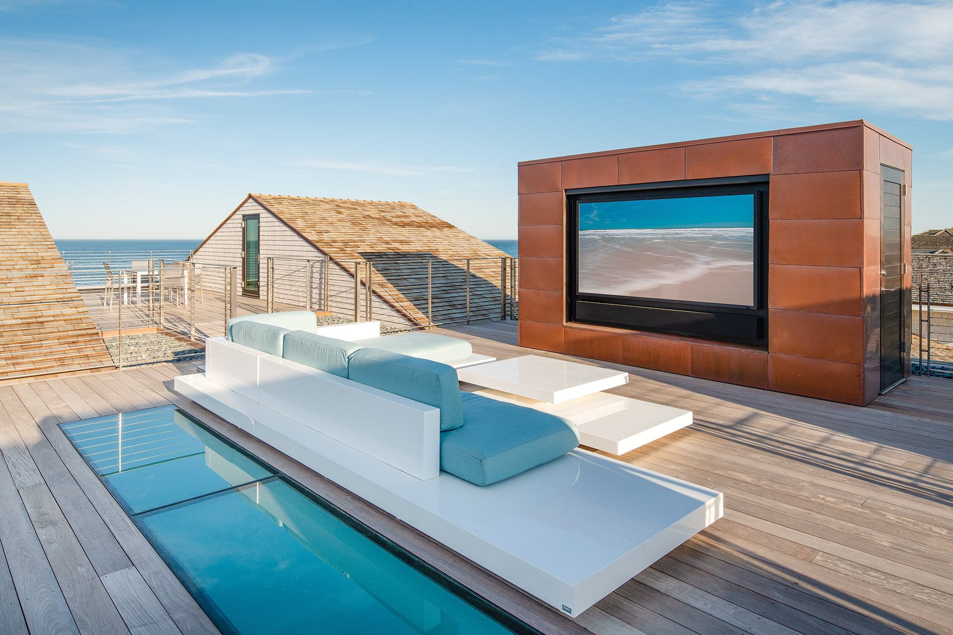 Platform sofa by Rausch Furniture and an outdoor TV on roof deck