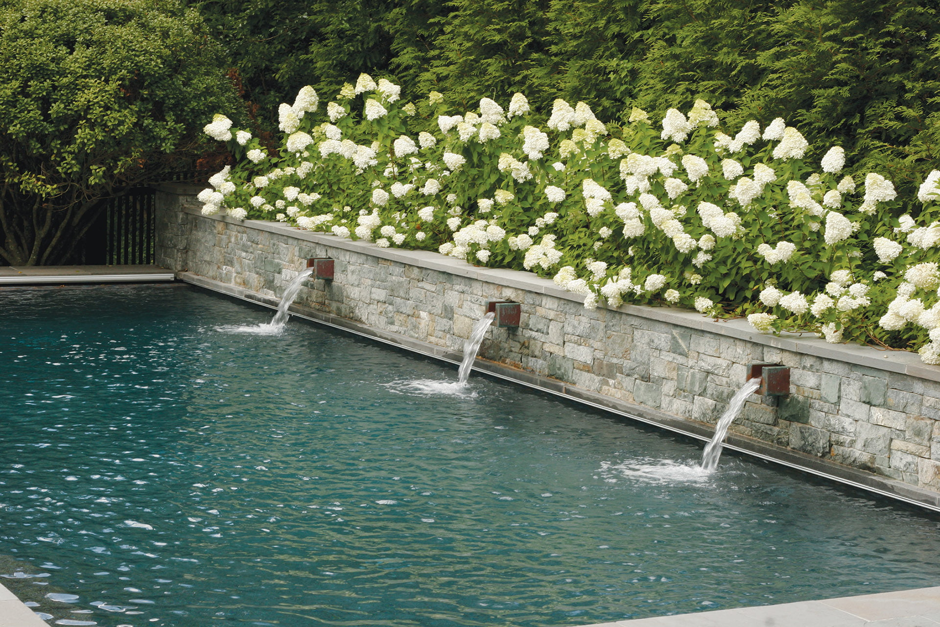 Colao & Peter, privacy wall that doubles as a water feature