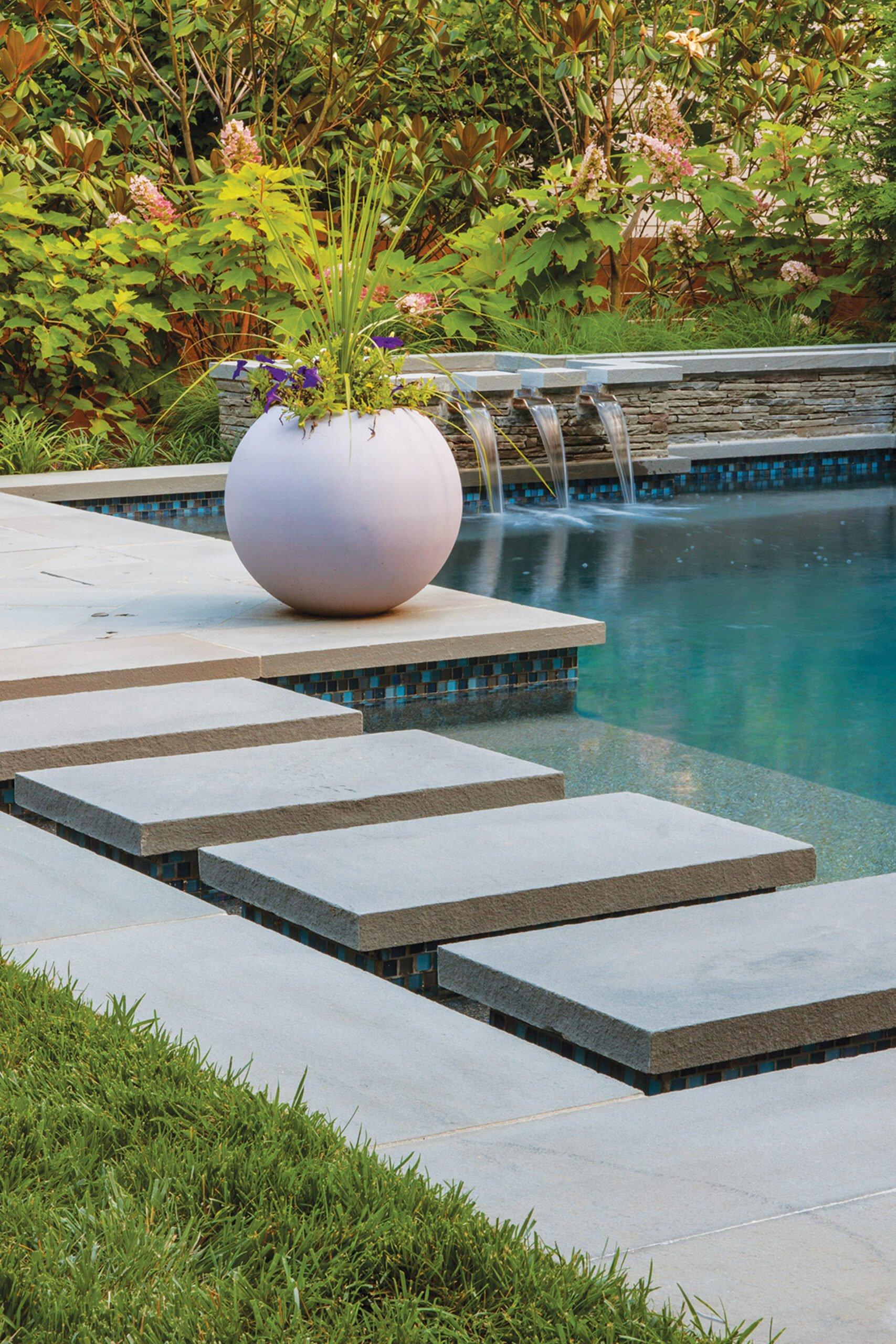 Sculptural planter adorns a pool scape, designed by Joseph Richardson Landscape Architecture